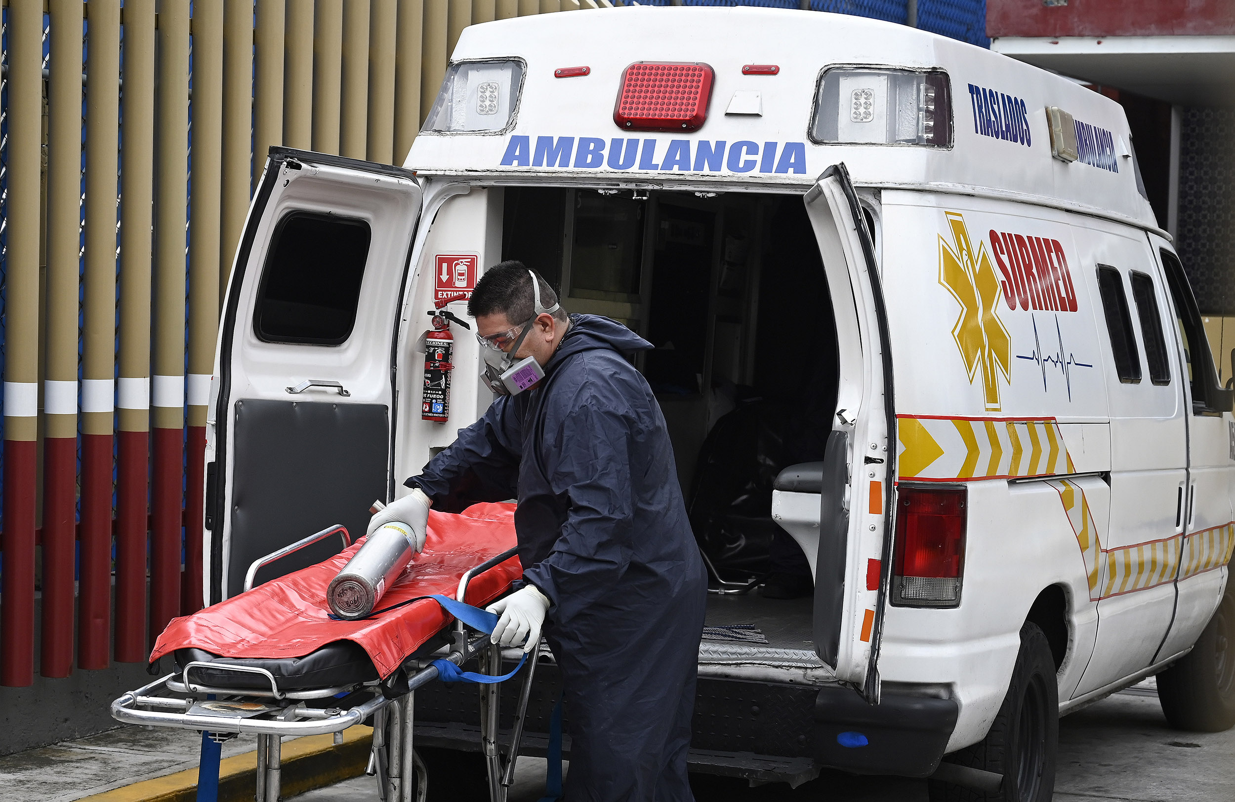 A paramedic prepares to move a patient suspected of having the novel coronavirus, at the Covid-19 triage area of the General Hospital in Mexico City on August, 20.