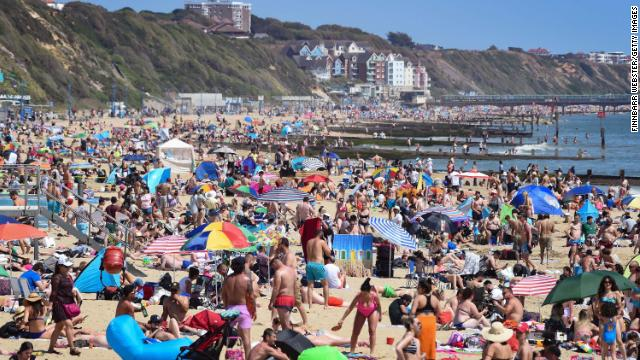 Tourists enjoy the hot weather at Bournemouth beach on May 25, after some coronavirus restrictions were eased.