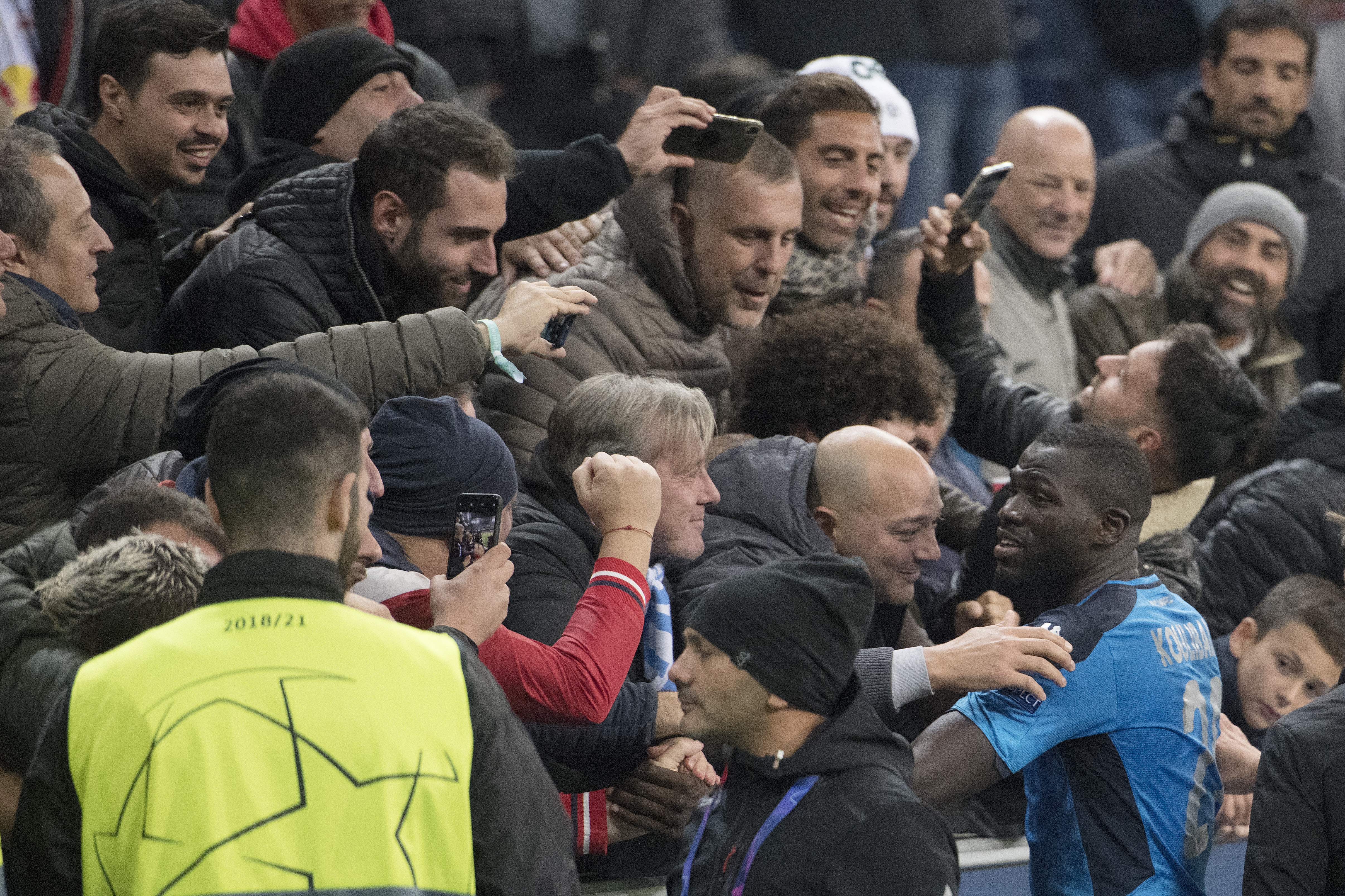 Kalidou Koulibaly celebrates with Napoli fans after the match.