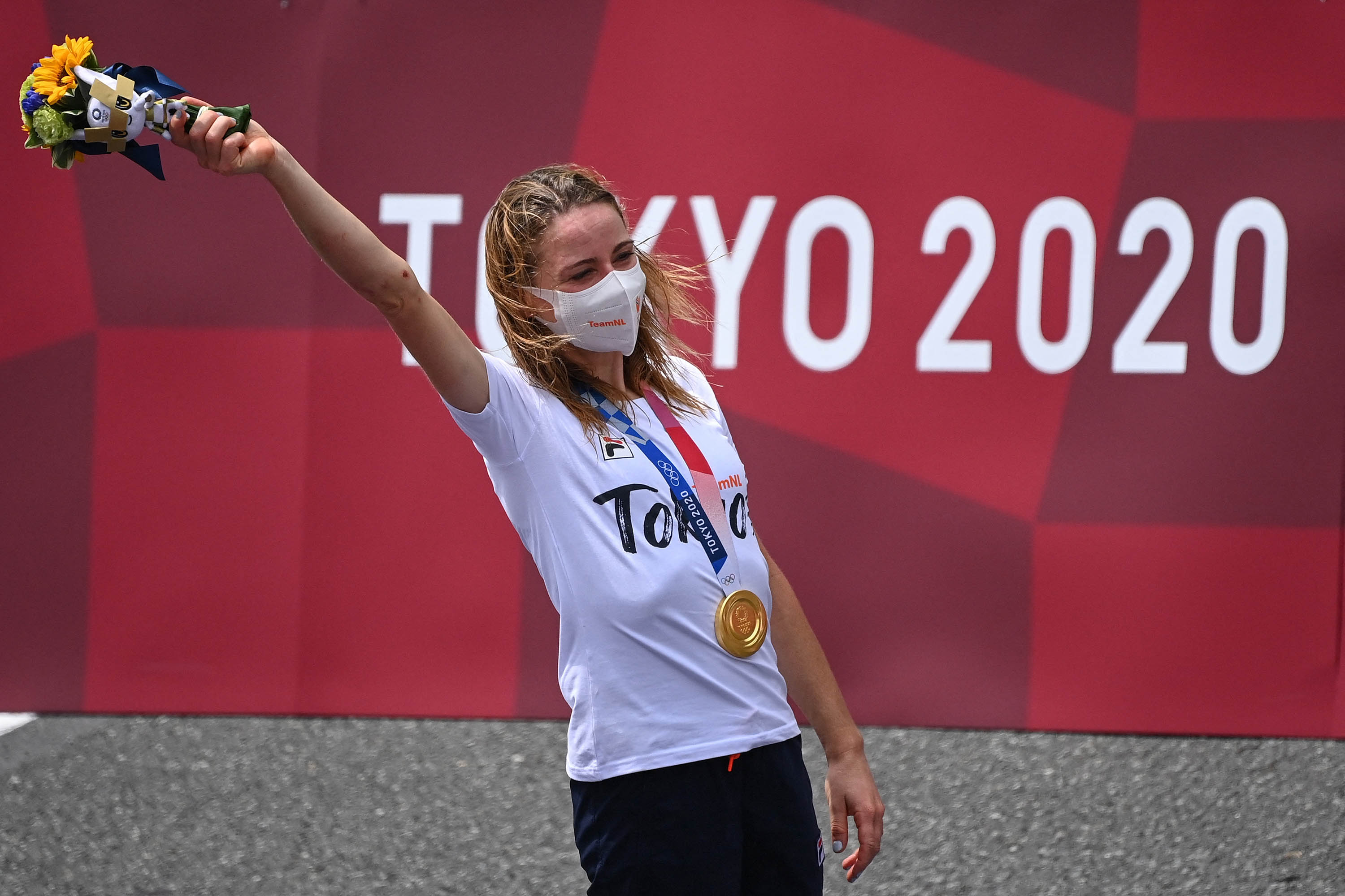 Gold medalist Annemiek Van Vleuten of The Nethterlands celebrates on the podium of the women's cycling road individual time trial in Oyama, Japan, on July 28.