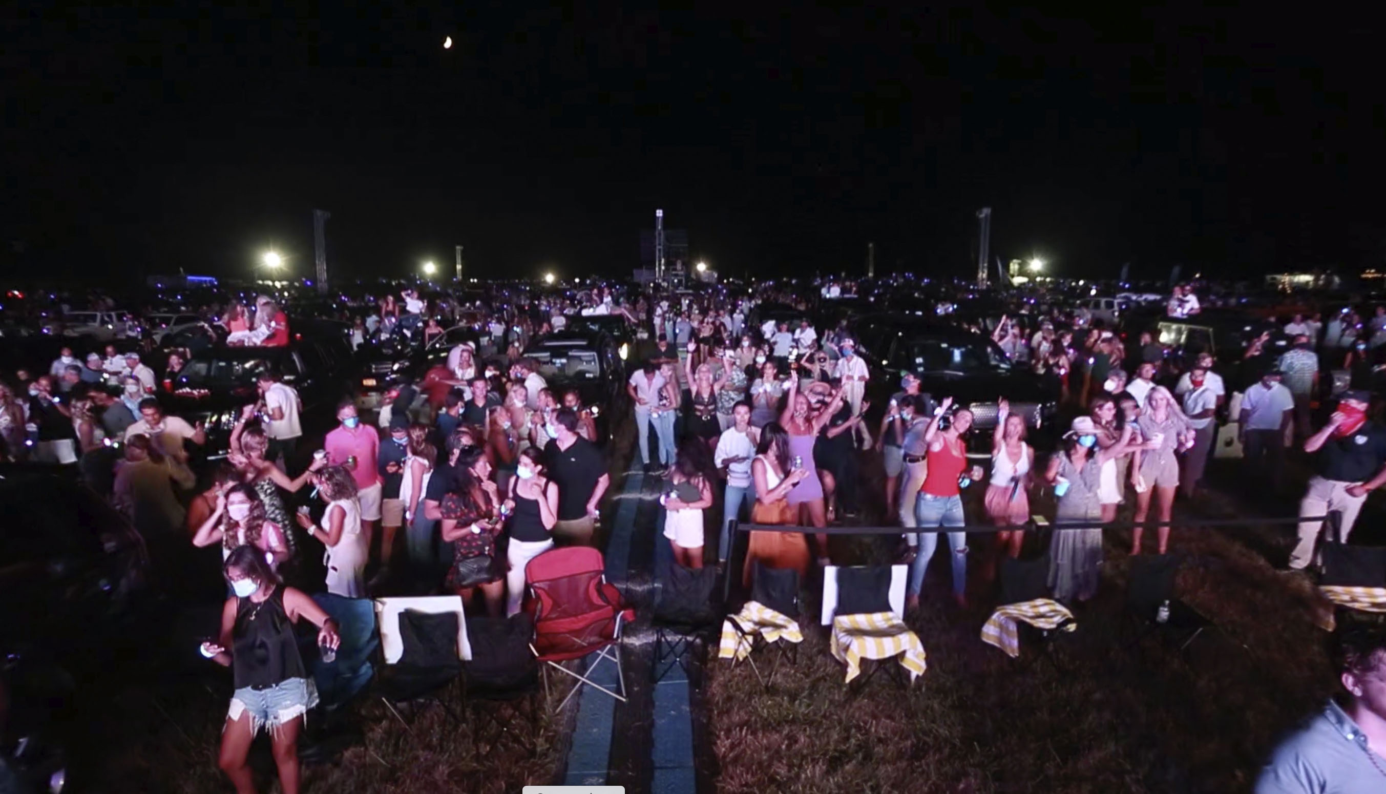 "People attend a ""Safe & Sound"" concert in Southhampton, New York, on July 25. This image is from video provided by Rich Schineller."