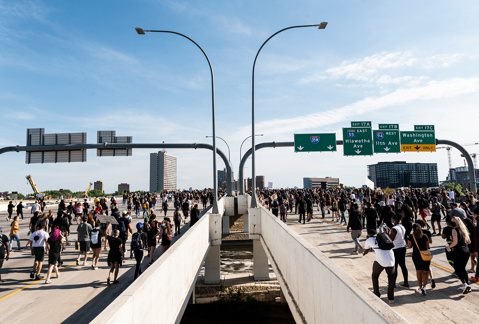 A crowd marches to protest the death of George Floyd on the I-35W bridge over the Mississippi River on May 31, in Minneapolis.