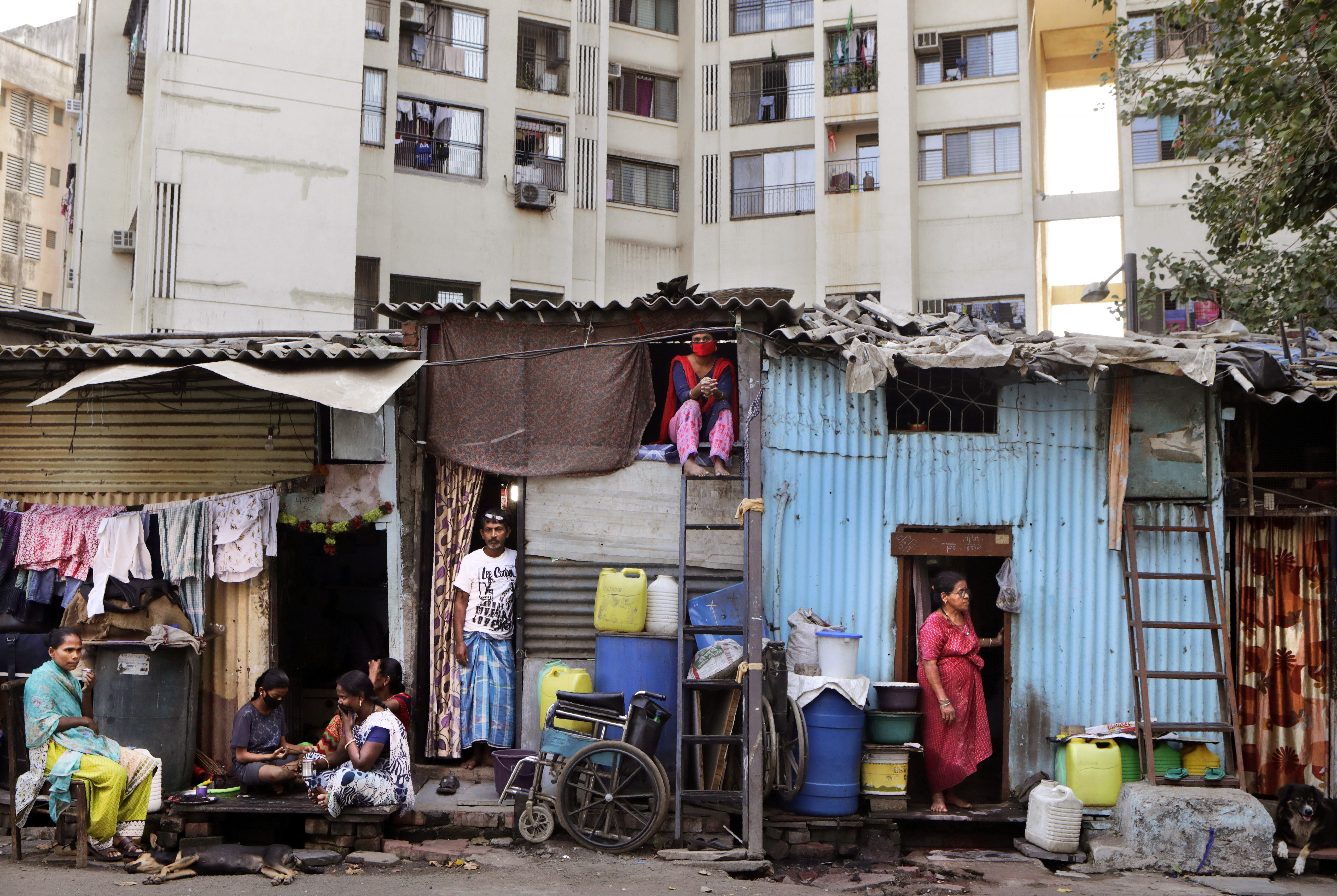 People rest by their homes in Dharavi, one of Asia's largest slums, in Mumbai, India, on April 3.
