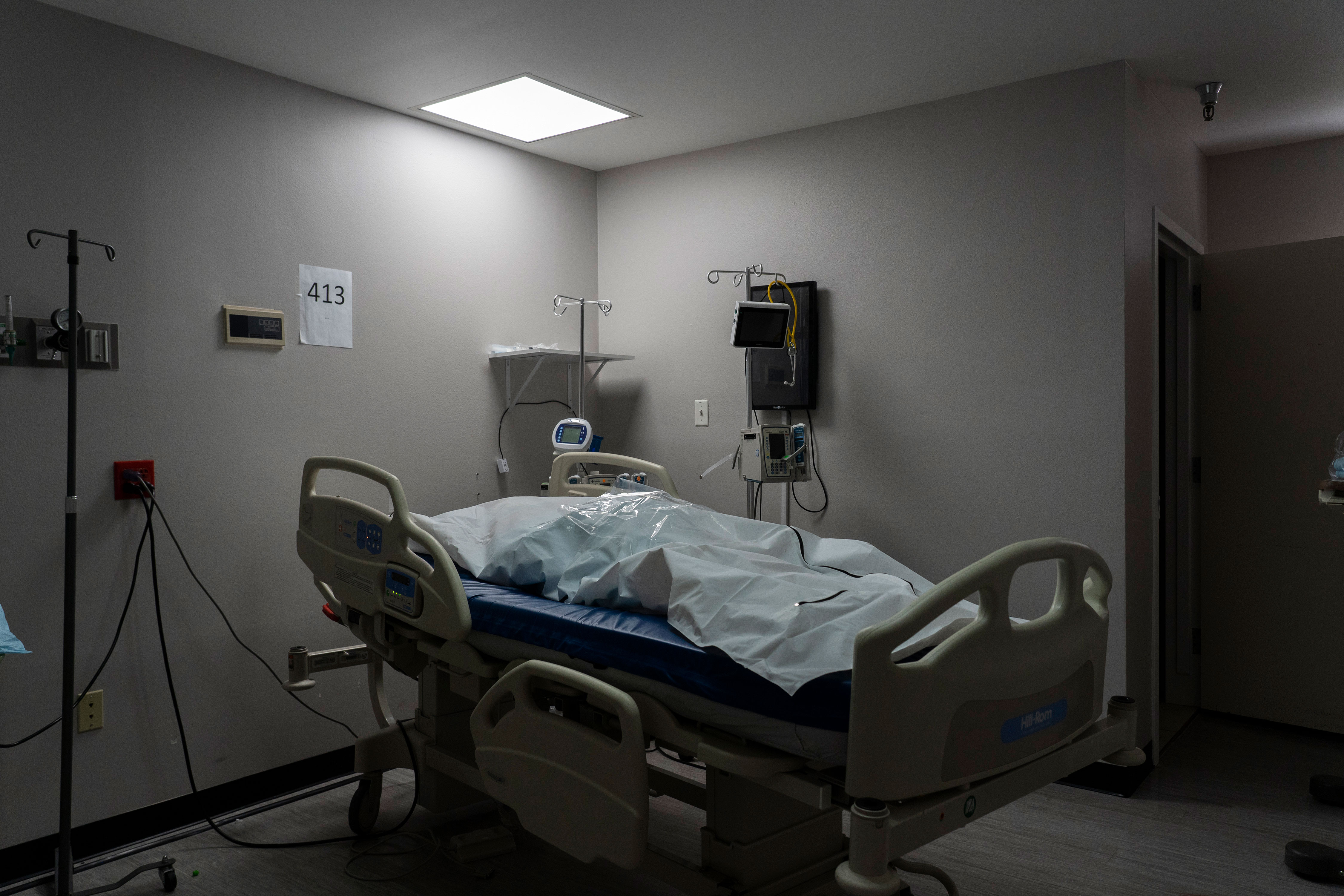 A deceased patient in a body bag is seen in the Covid-19 intensive care unit at United Memorial Medical Center in Houston on November 29.