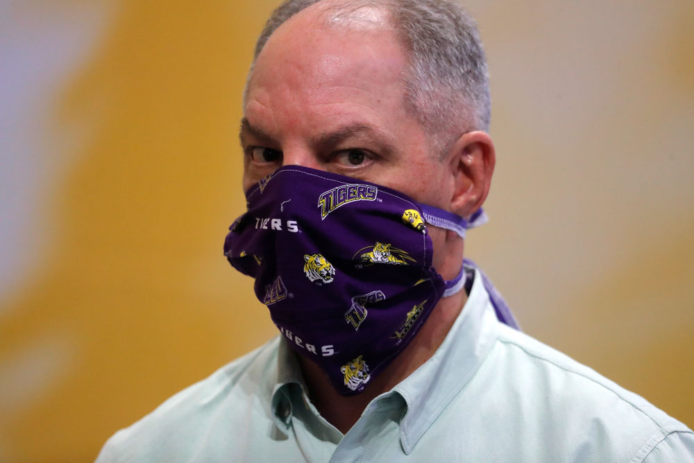 Louisiana Gov. John Bel Edwards wears a face mask as he visits a production site on the LSU campus in Baton Rouge, Louisiana, where the school is manufacturing personal protection equipment for hospitals in response to the coronavirus pandemic Friday, April 17.