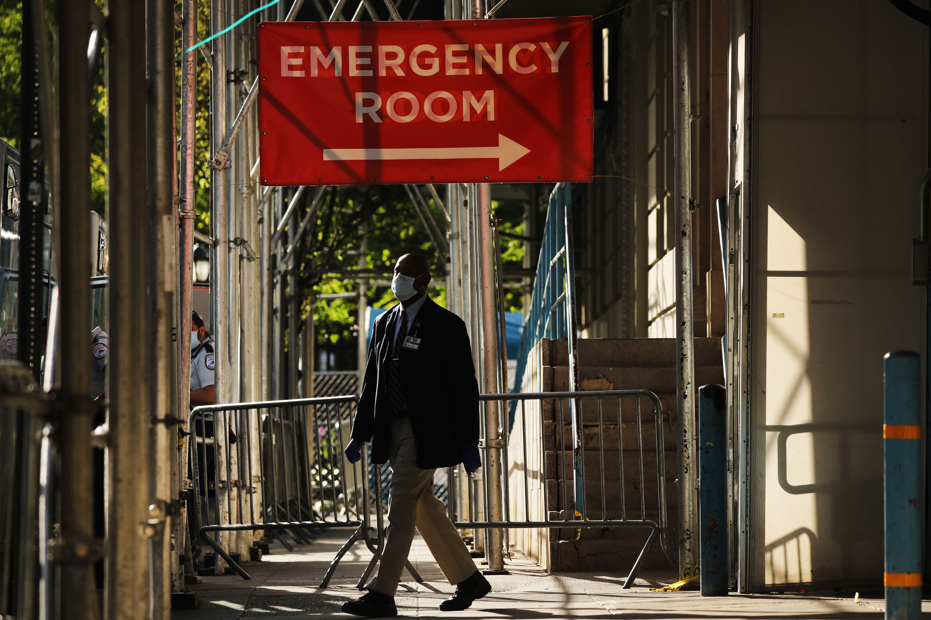 A sign at a Manhattan hospital treating coronavirus patients directs visitors to the emergency room entrance on May 12 in New York.