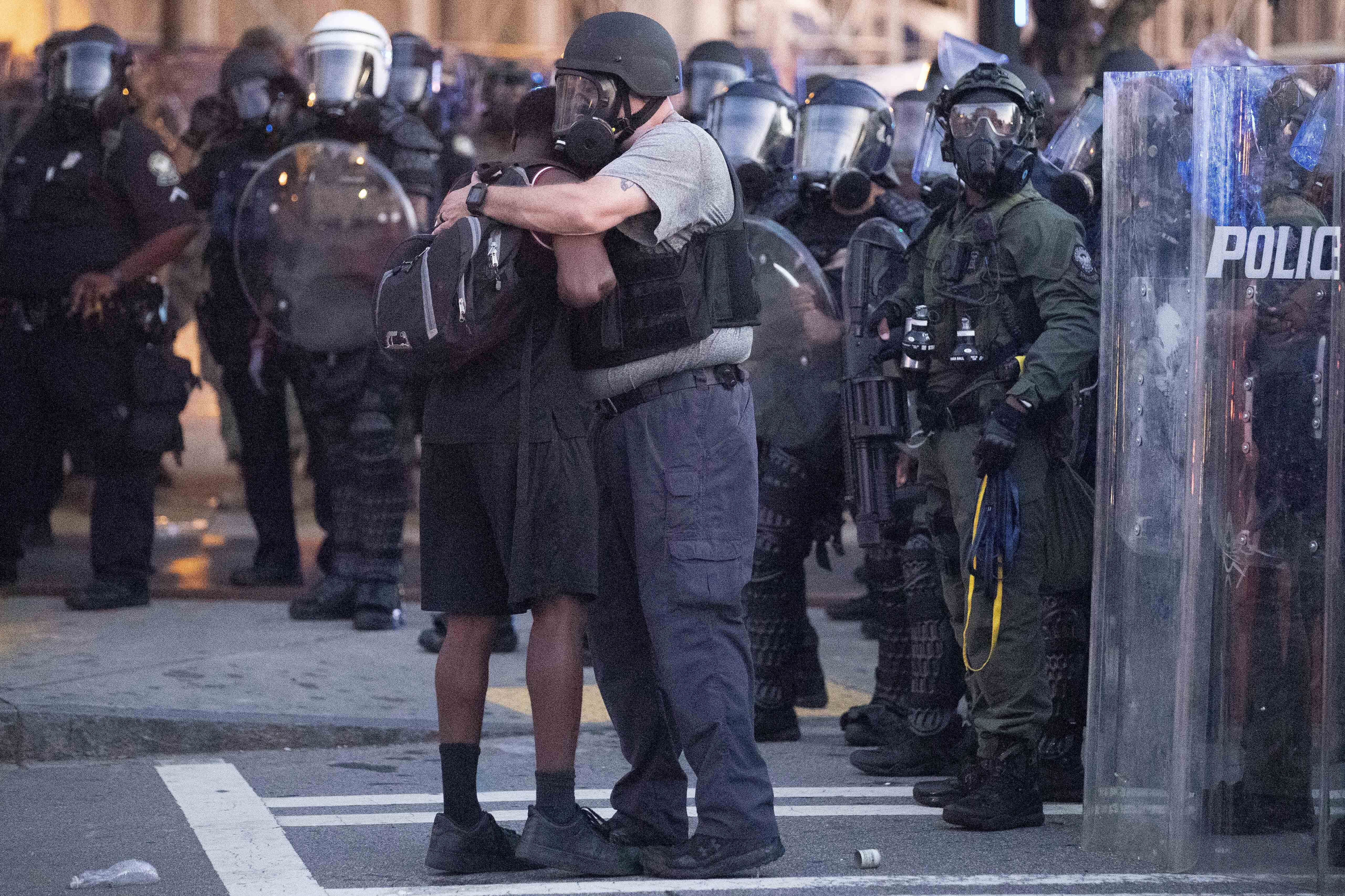 A police officer embraces a protester in Atlanta on June 1.