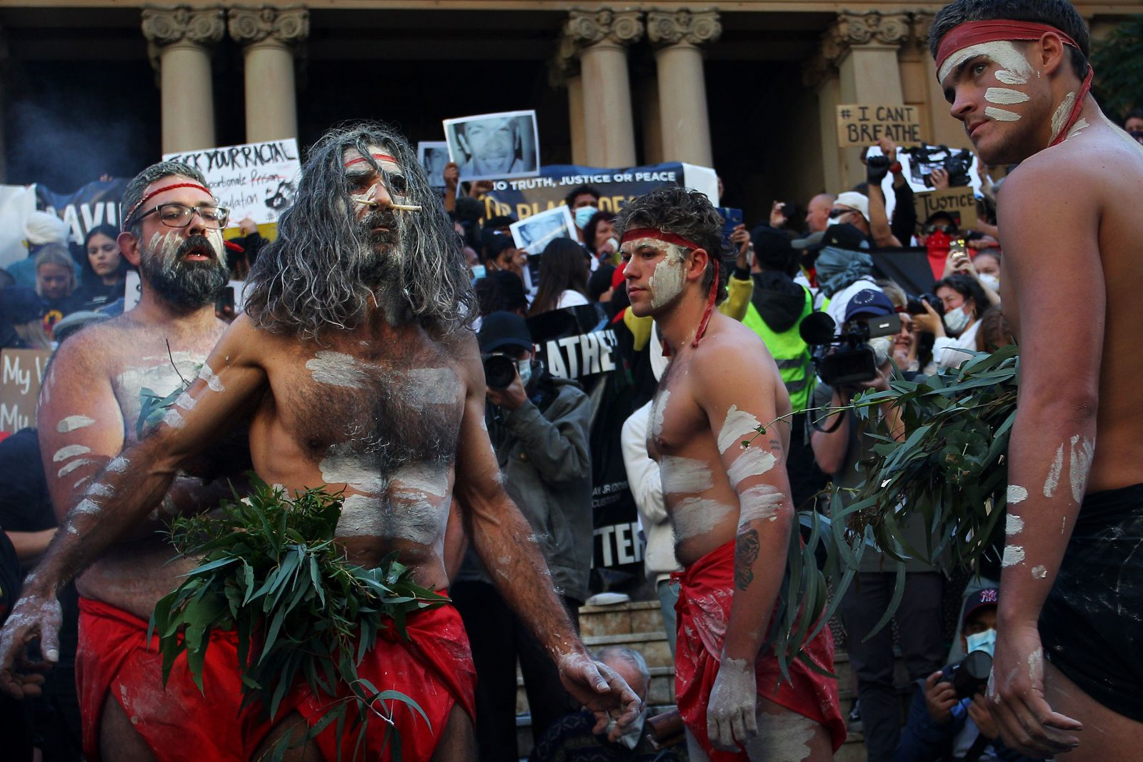 Indigenous protesters conduct a traditional smoking ceremony at Town Hall in Sydney, Australia, on June 6.