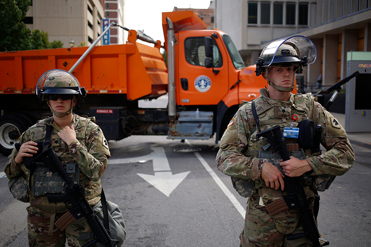Kentucky Army National Guard soldiers stand guard during a protest in Louisville, Kentucky, on Thursday, September 24.