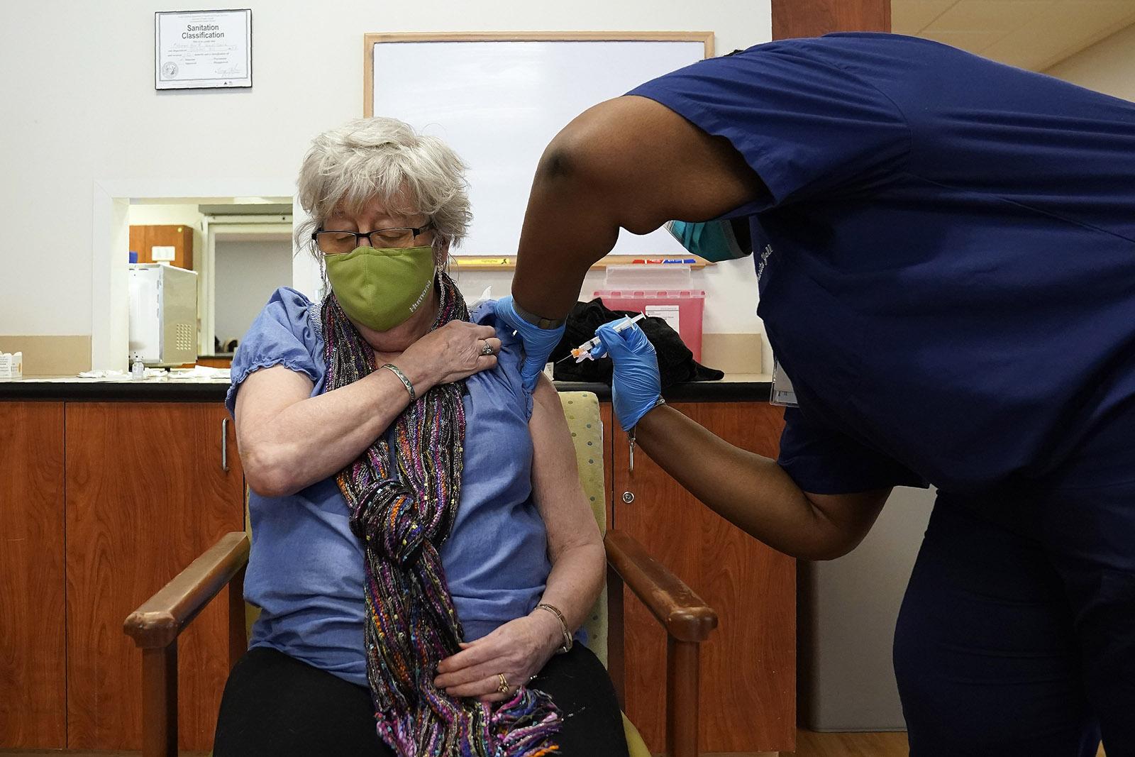 Martha Wilson, of Chapel Hill, gets a Covid-19 vaccine Thursday, January 28, in Pittsboro, North Carolina, at Piedmont Health Senior Care.