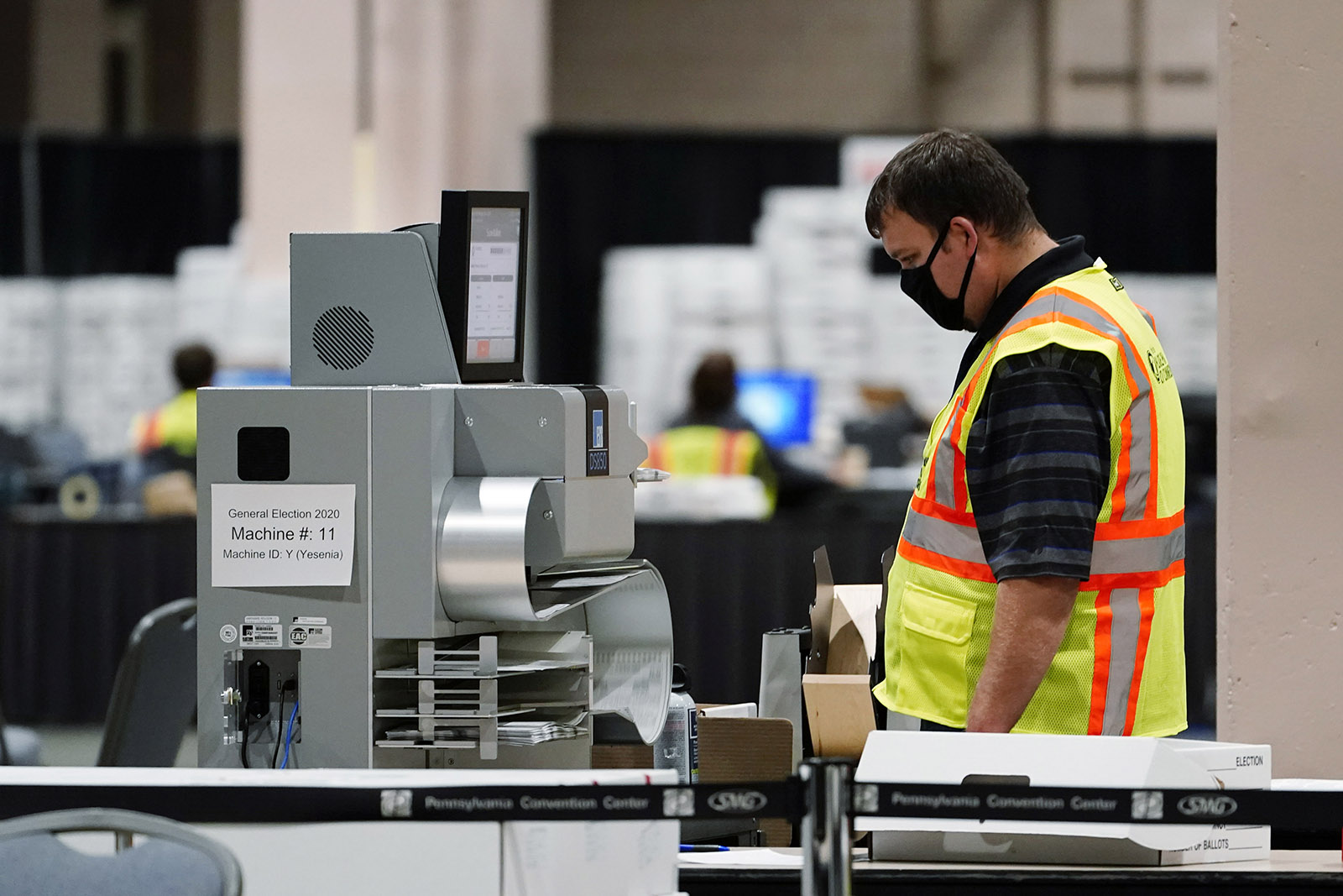 A Philadelphia election worker scans ballots for the 2020 general election in the United States at the Pennsylvania Convention Center, on Tuesday in Philadelphia.