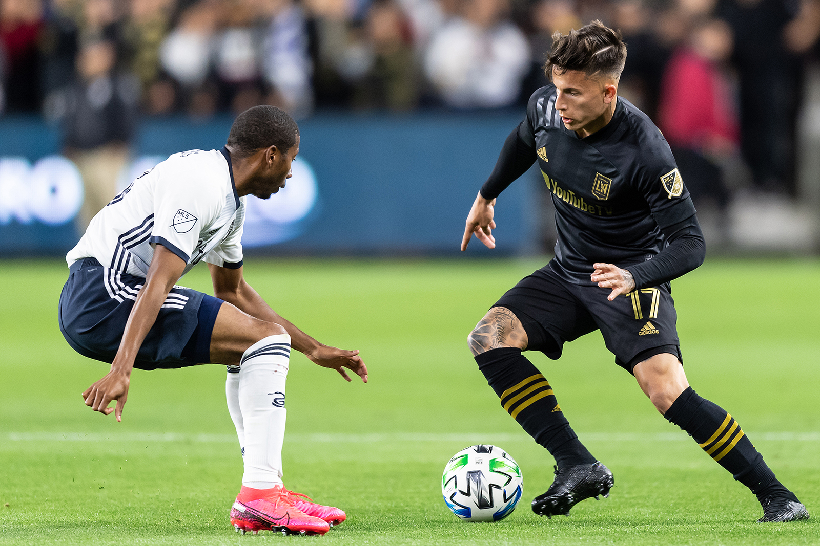 Brian Rodriguez (right) of Los Angeles FC up against a Philadelphia Union player during a game at Banc of California Stadium in Los Angeles, California on March 08 .