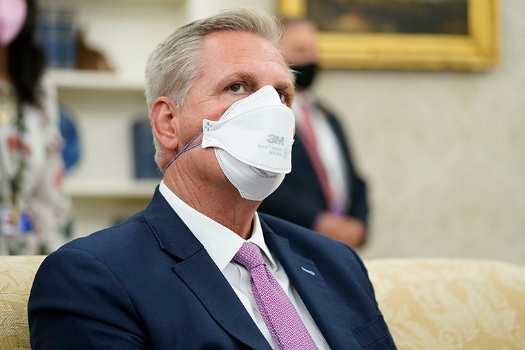 McCarthy attends a meeting with President Joe Biden and congressional leaders in the Oval Office of the White House, Wednesday, May 12.