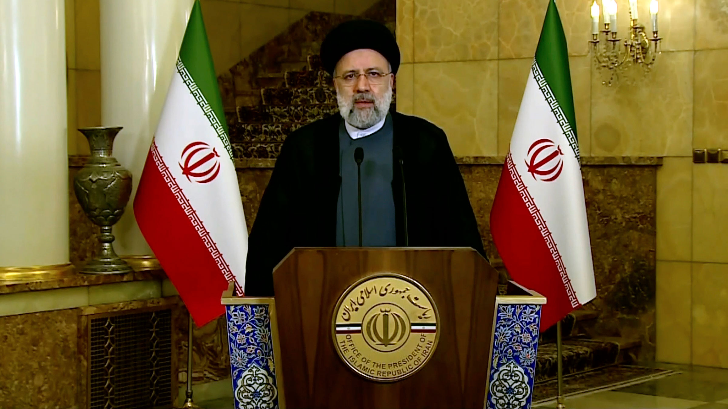 In this image taken from video, Iranian President Ebrahim Raisi remotely addresses the General Assembly on Tuesday.
