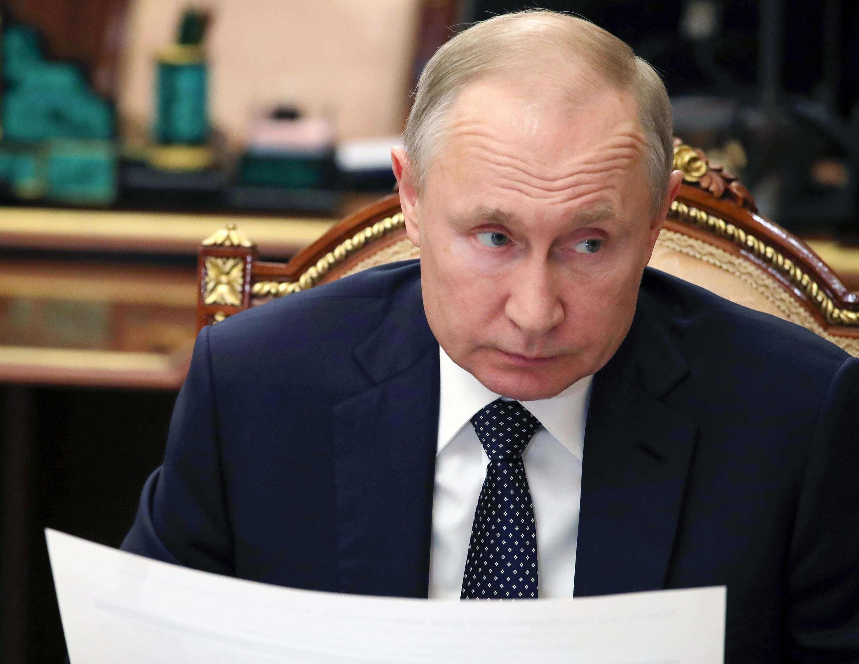 Russian President Vladimir Putin listens during a meeting in the Kremlin, in Moscow, Russia, Monday, April 6.