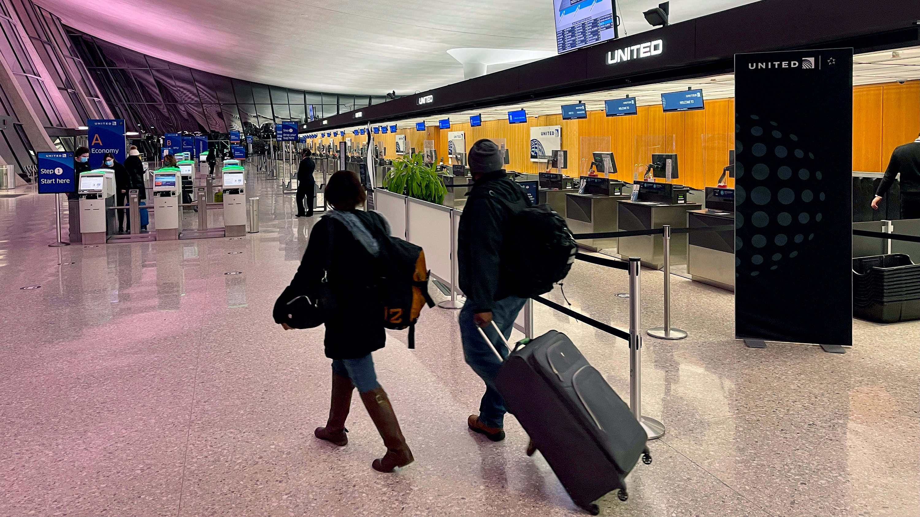 Travelers walk through Dulles International Airport in Dulles, Virginia, on March 2.