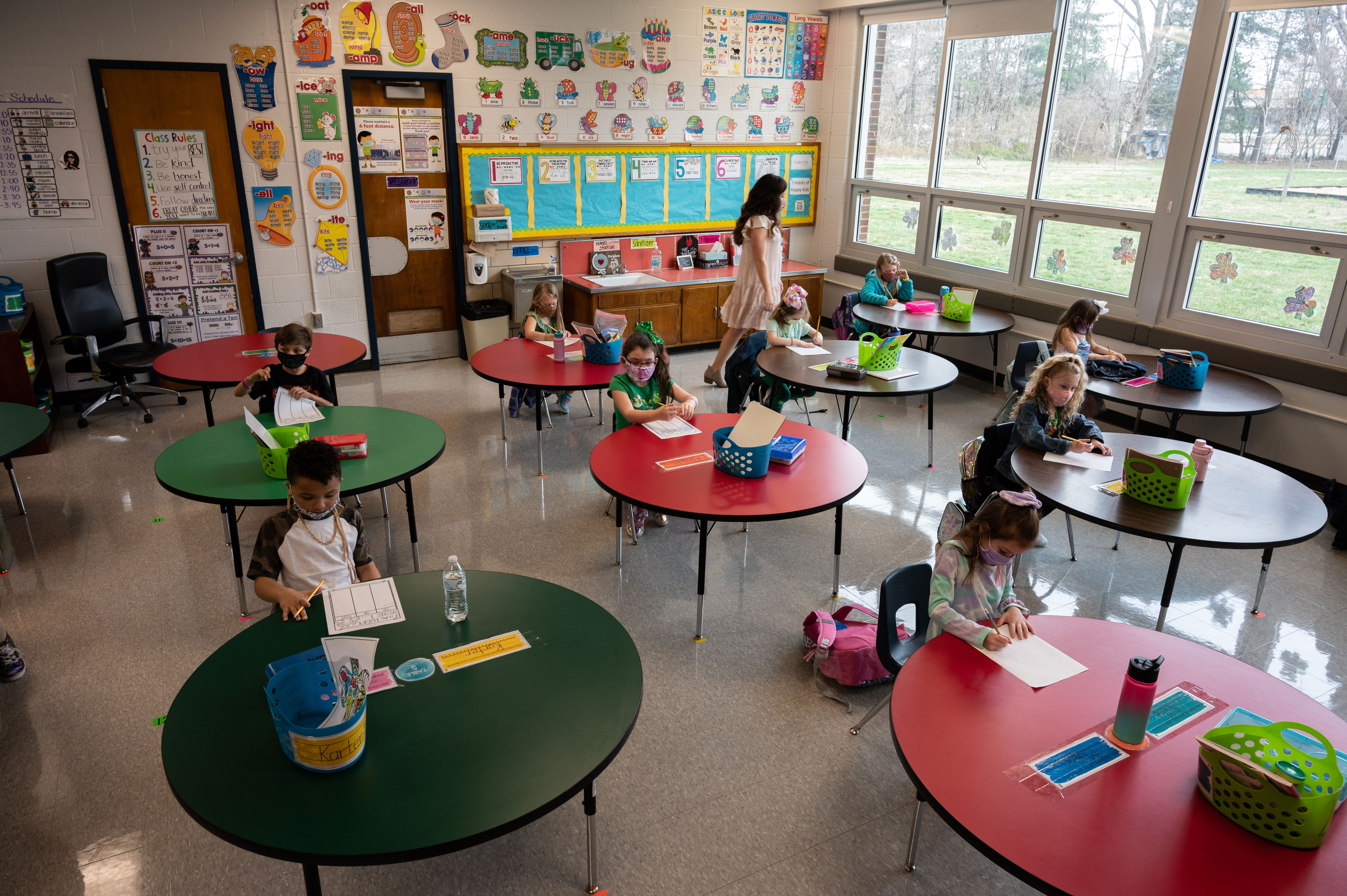 Students work in a classroom at an elementary school in Louisville, Kentucky, on March 17, 2021.