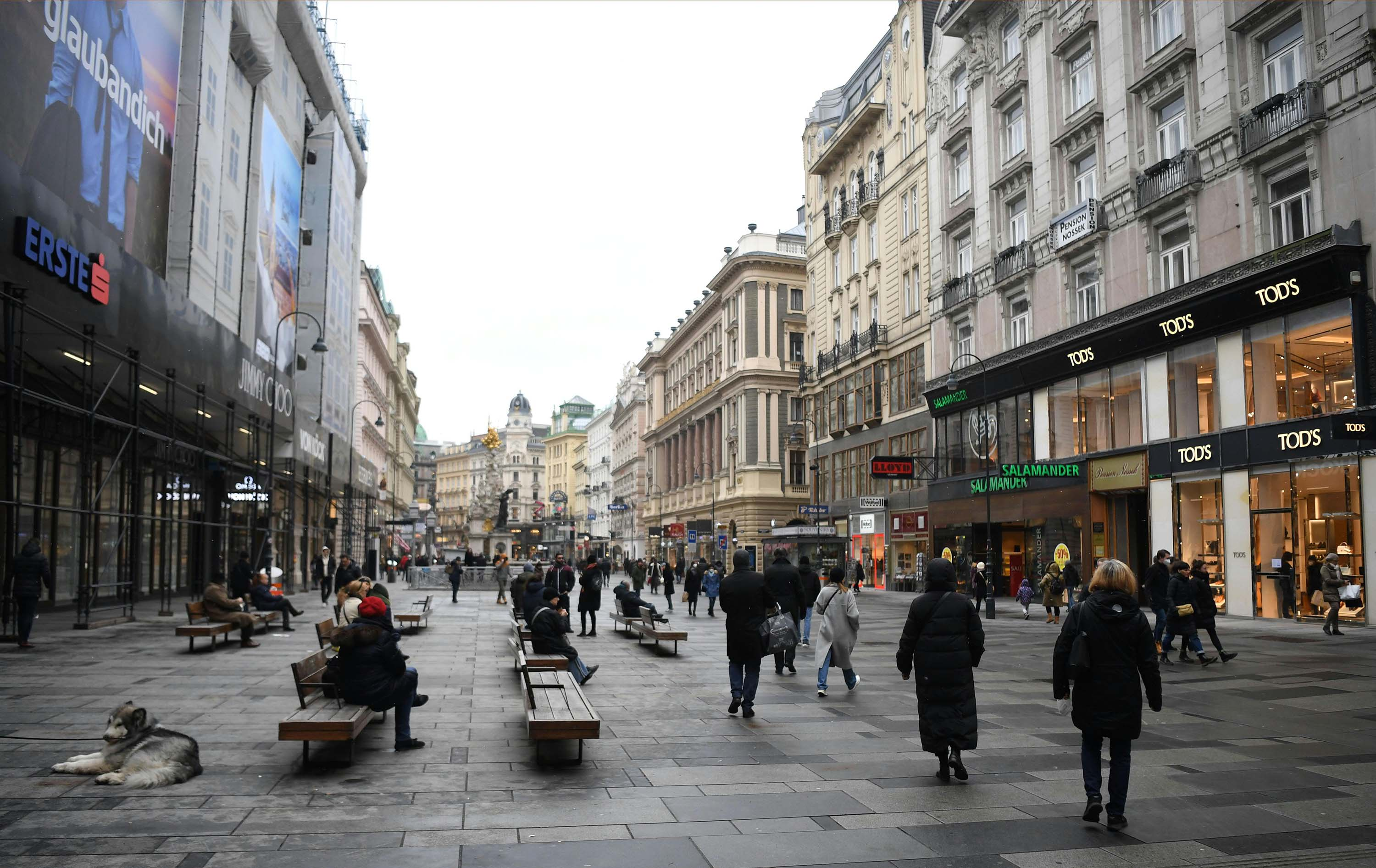 People shop in Vienna's Kaerntner Street as Austria reduces its lockdown restrictions on February 8.