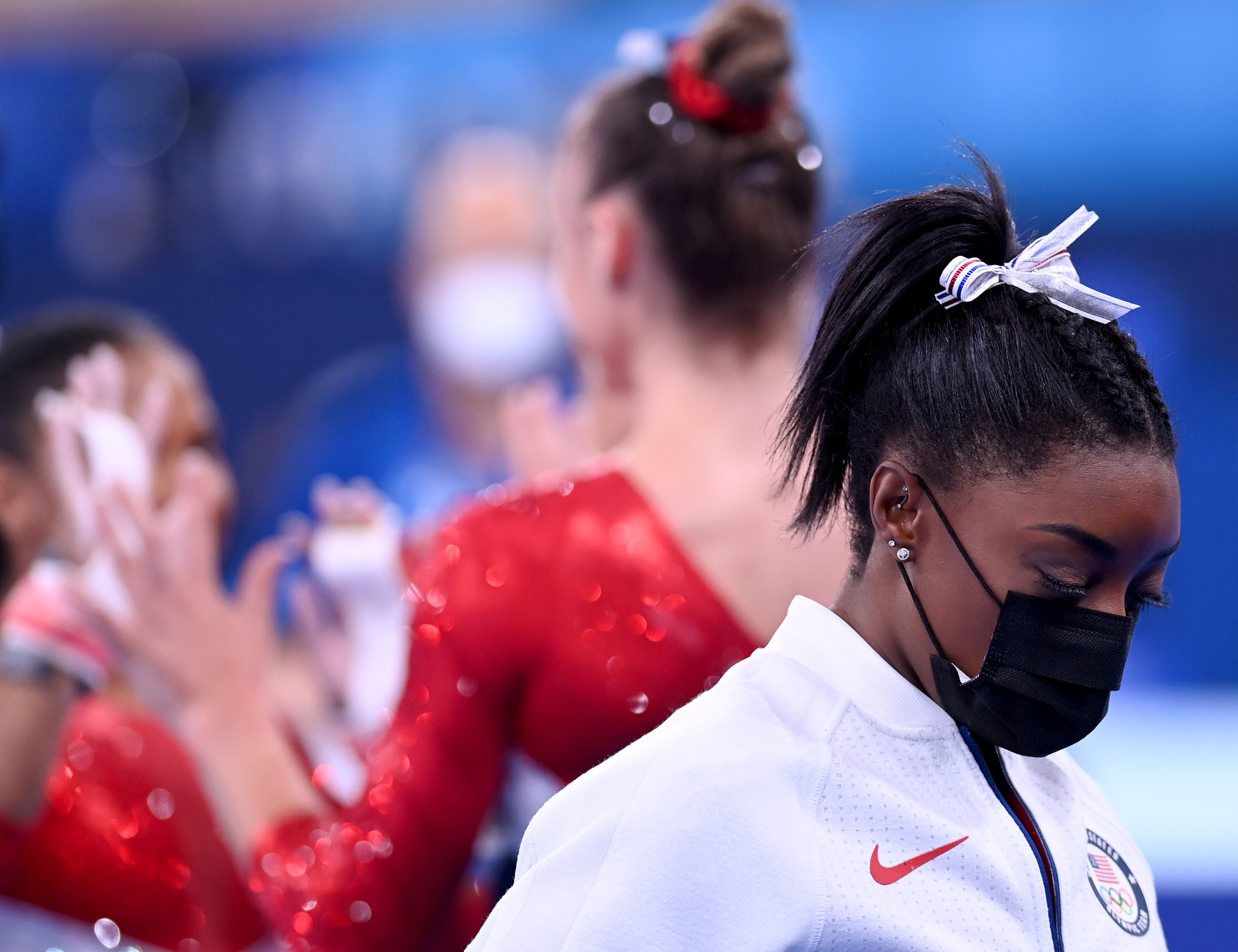 American gymnast Simone Biles watches the team finals after leaving the competition due to mental health concerns on July 27.