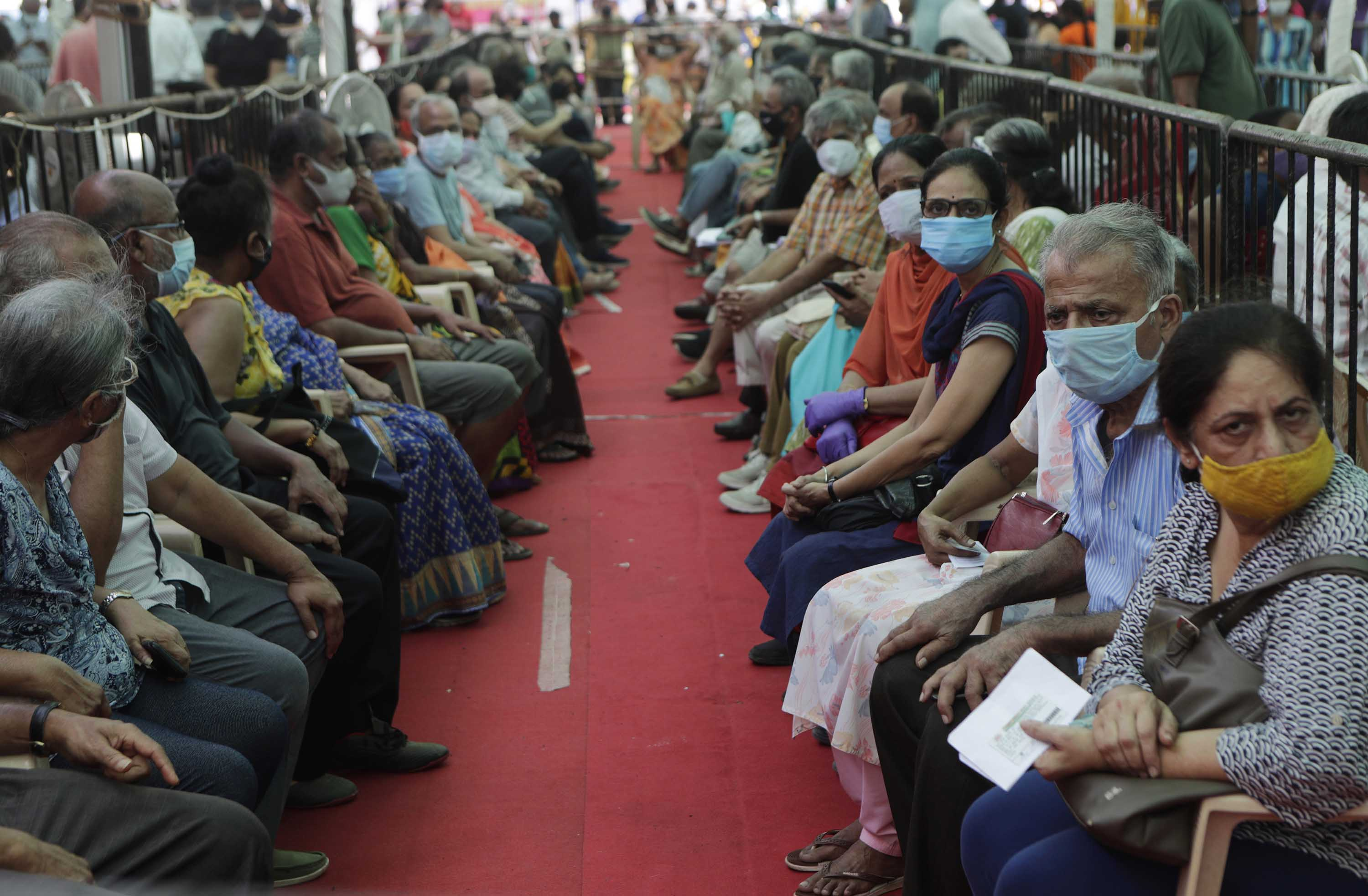 People wait to receive a Covid-19 vaccine in Mumbai, India, on Thursday, April 29.