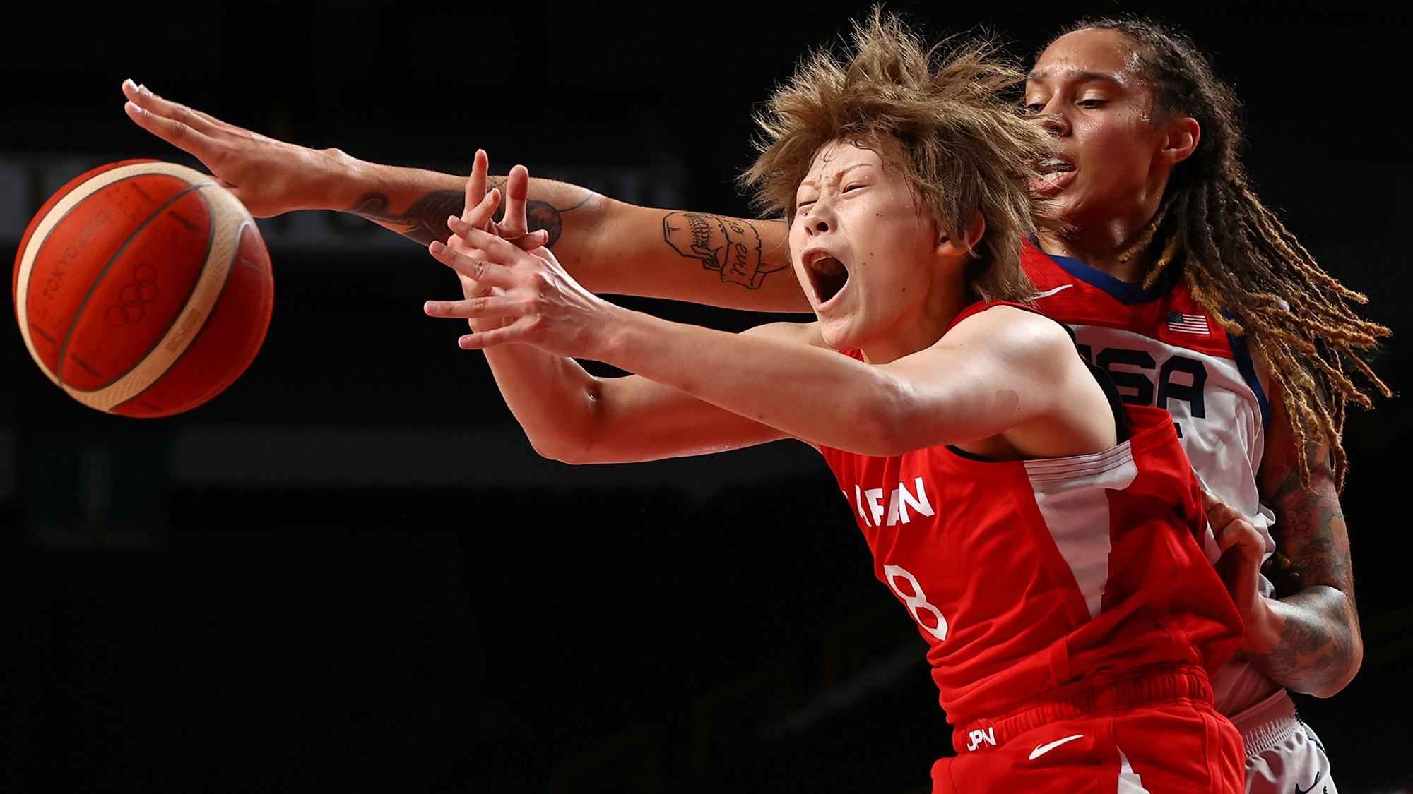 The United States' Brittney Griner, right, defends Japan's Maki Takada during the gold-medal basketball game on Sunday, August 8.