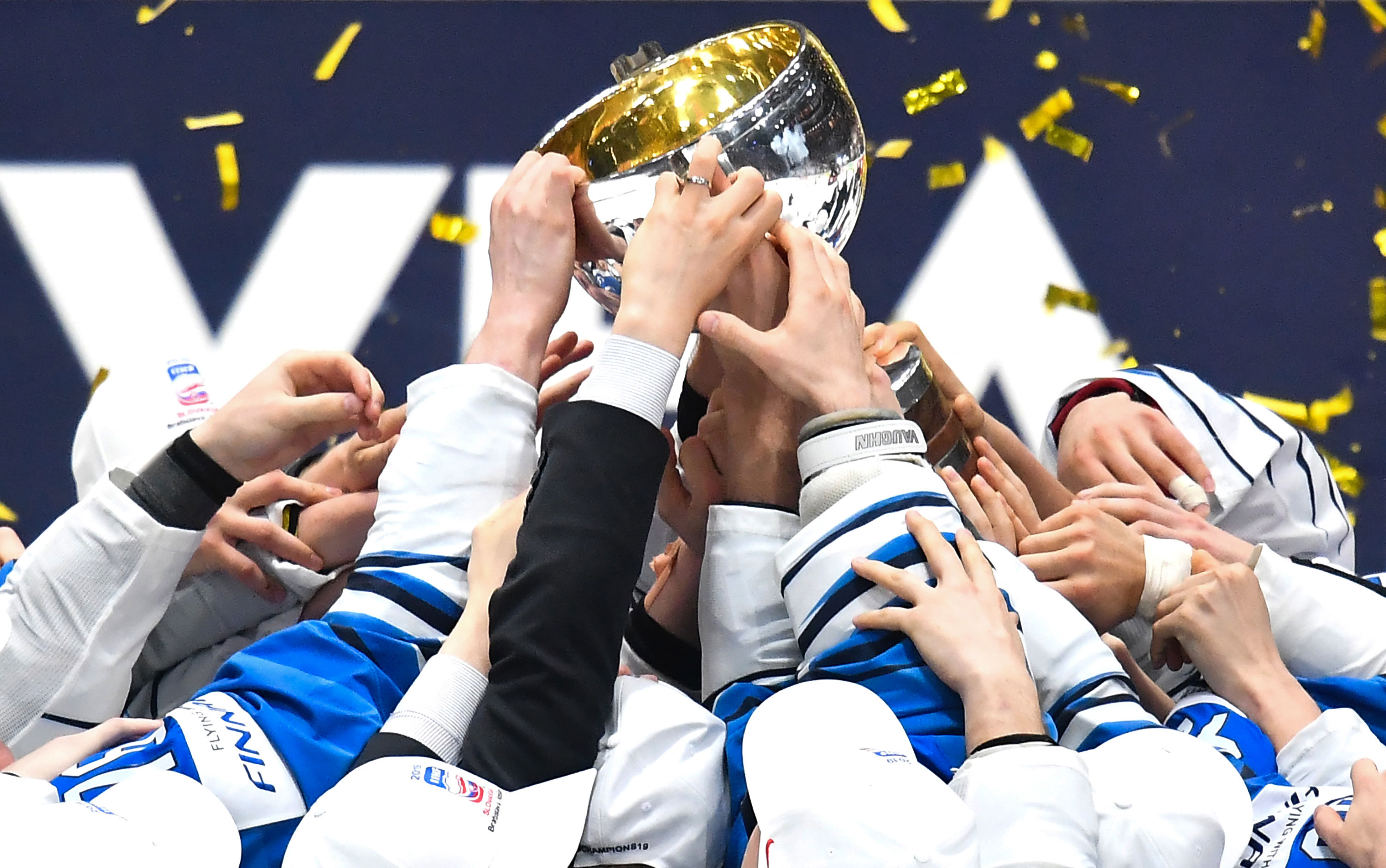 Finland's players celebrate after winning the Men's Ice Hockey World Championships final against Canada on May 26, 2019 in Bratislava, Slovakia.
