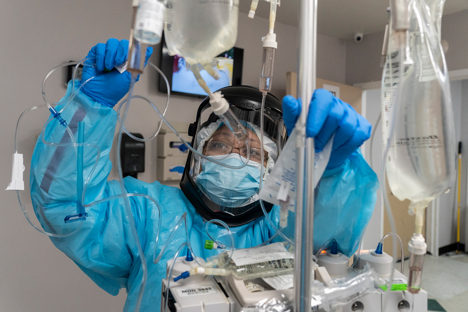 A medical staff member checks the IV drip for a patient in the Covid-19 intensive care unit during Thanksgiving at the United Memorial Medical Center on Nov. 26, in Houston, Texas.