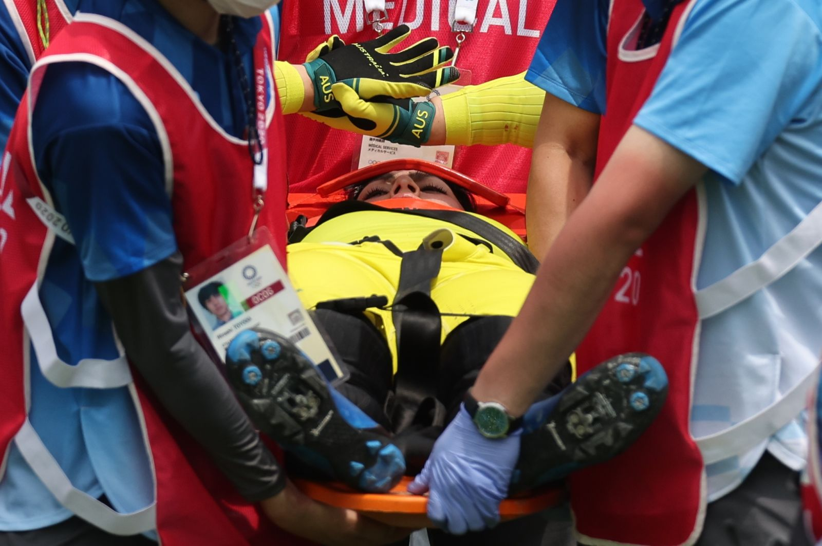 Australia's Saya Sakakibara receives medical attention aftera crash in the BMX racing semifinalon July 30. She was leading the race when she went down.