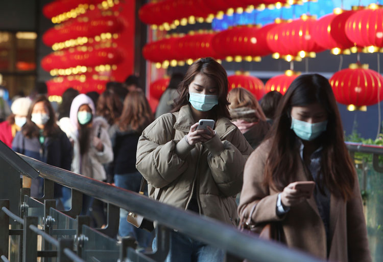 People wear face masks and walk at a shopping mall in Taipei, Taiwan, Friday, January 31.