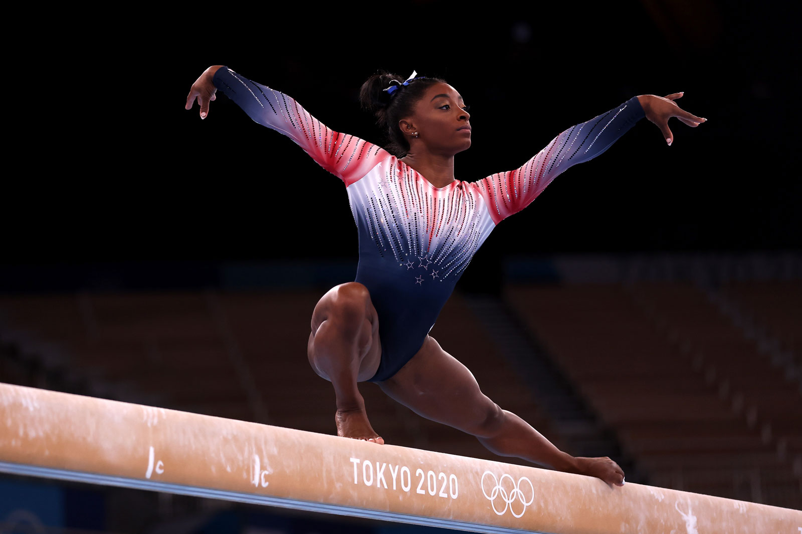 Simone Biles warms up on the balance beam prior to Tuesday's final.