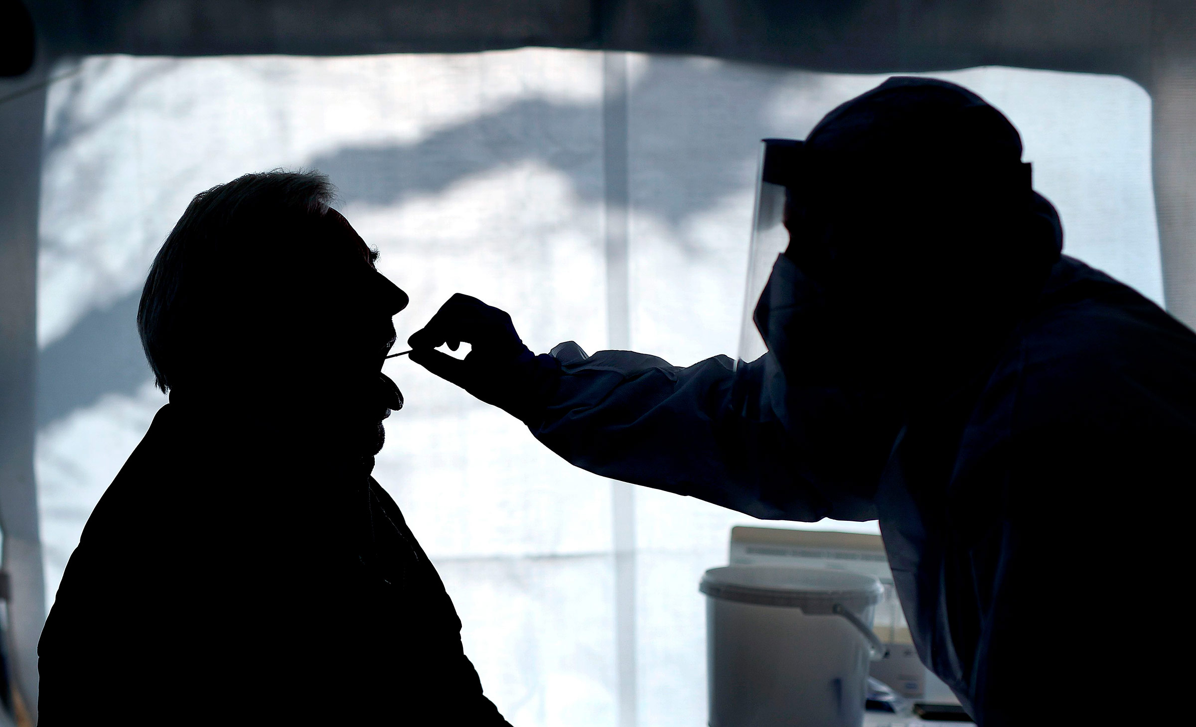 A health worker administers a Covid-19 test in Naumburg, Germany, on February 3.