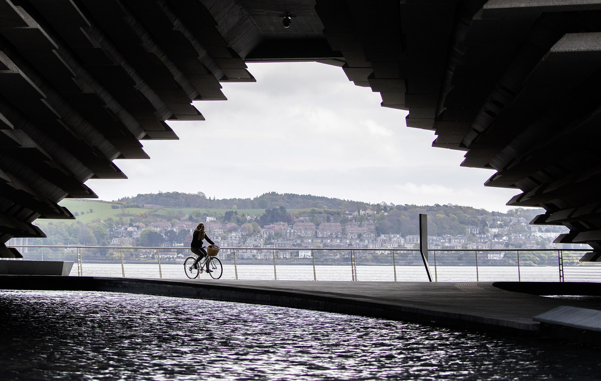 A cyclist passes the closed V&A Museum in Dundee, Scotland as the United Kingdom continues in lockdown to help curb the spread of the coronavirus on May 3.