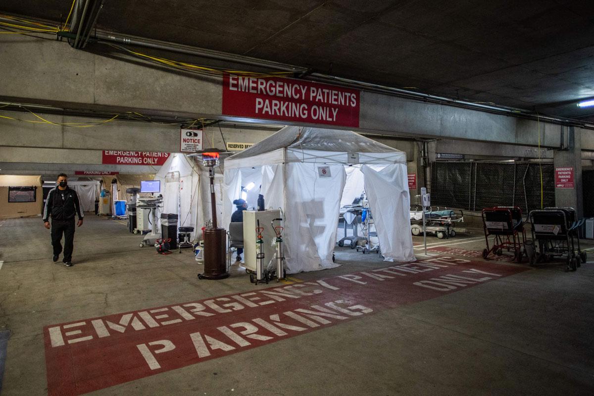 Medical Director of Providence Cedars-Sinai Tarzana Medical Center's intensive care unit, Dr. Thomas Yadegar, walks inside a temporary emergency room built into a parking garage in Tarzana, California on January3.