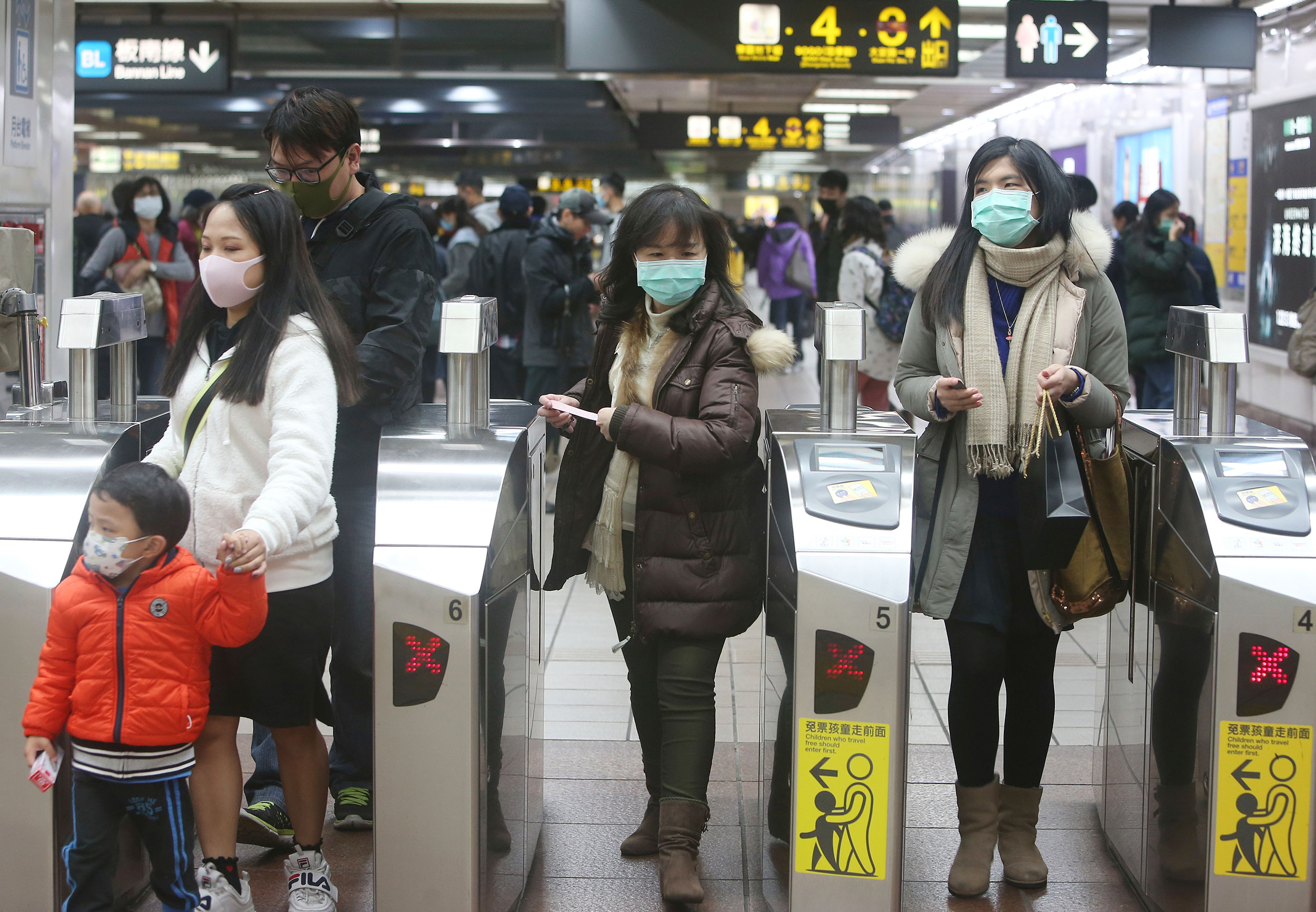 People wear masks at a metro station in Taipei on January 28.