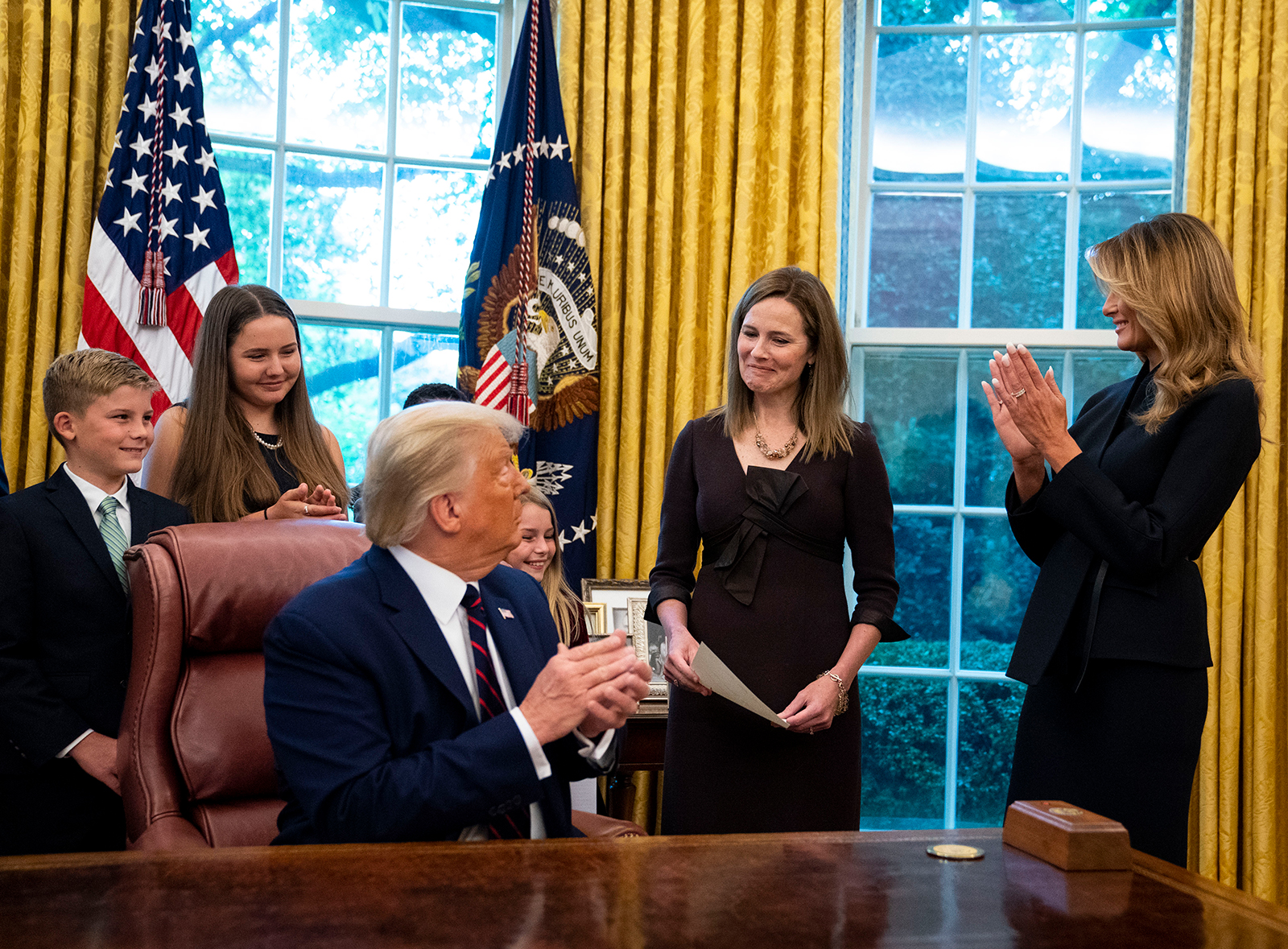 First lady Melania Trump applauds Judge Amy Coney Barrett in the Oval Office prior to the official announcement on Saturday, September 26.