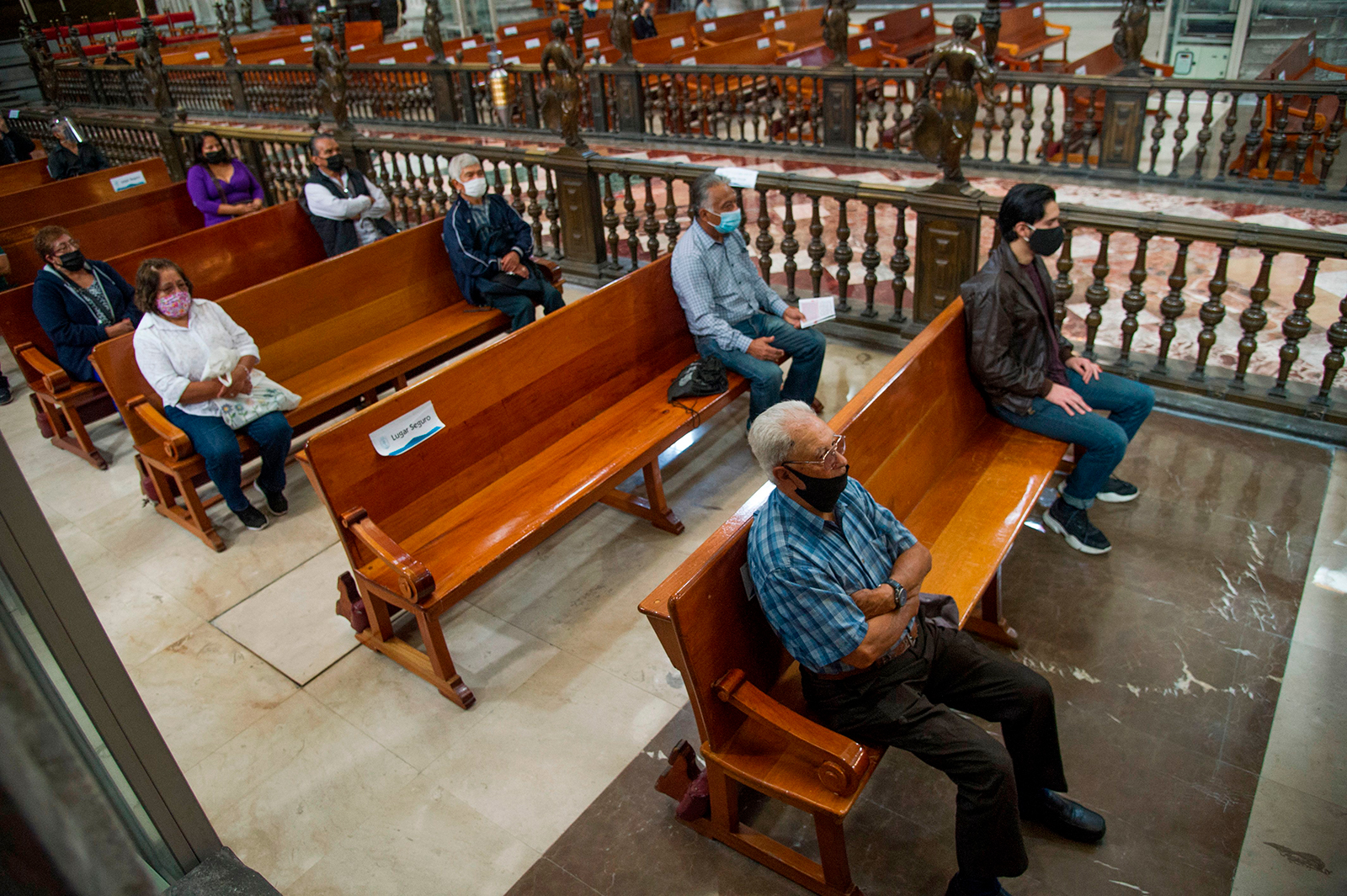 Churchgoers keep social distancing during the first mass in the Metropolitan Cathedral in Mexico City, on July 26.