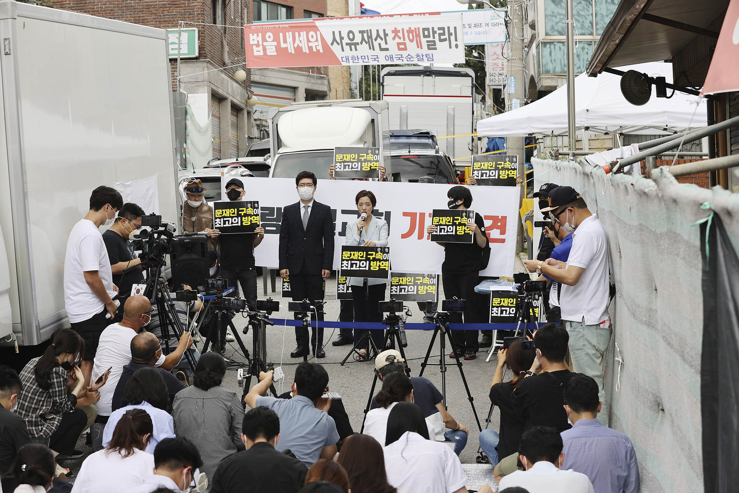 Sarang-jeil Church pastor Jun Kwang-hun's lawyer, Kang Yeon-jae, top center, speaks during a news conference near the church in Seoul, South Korea, on Monday, August 17.