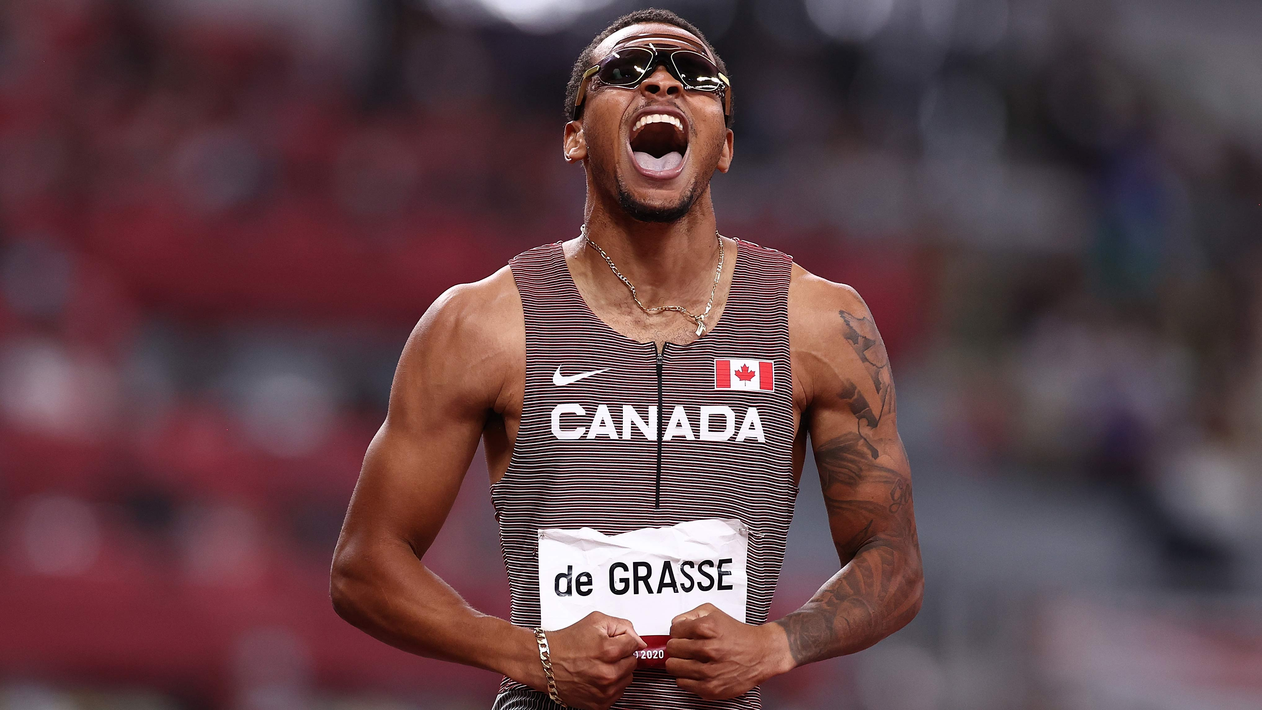 Canada's Andre de Grasse celebrates after winning the gold medal in the 200m on August 4.