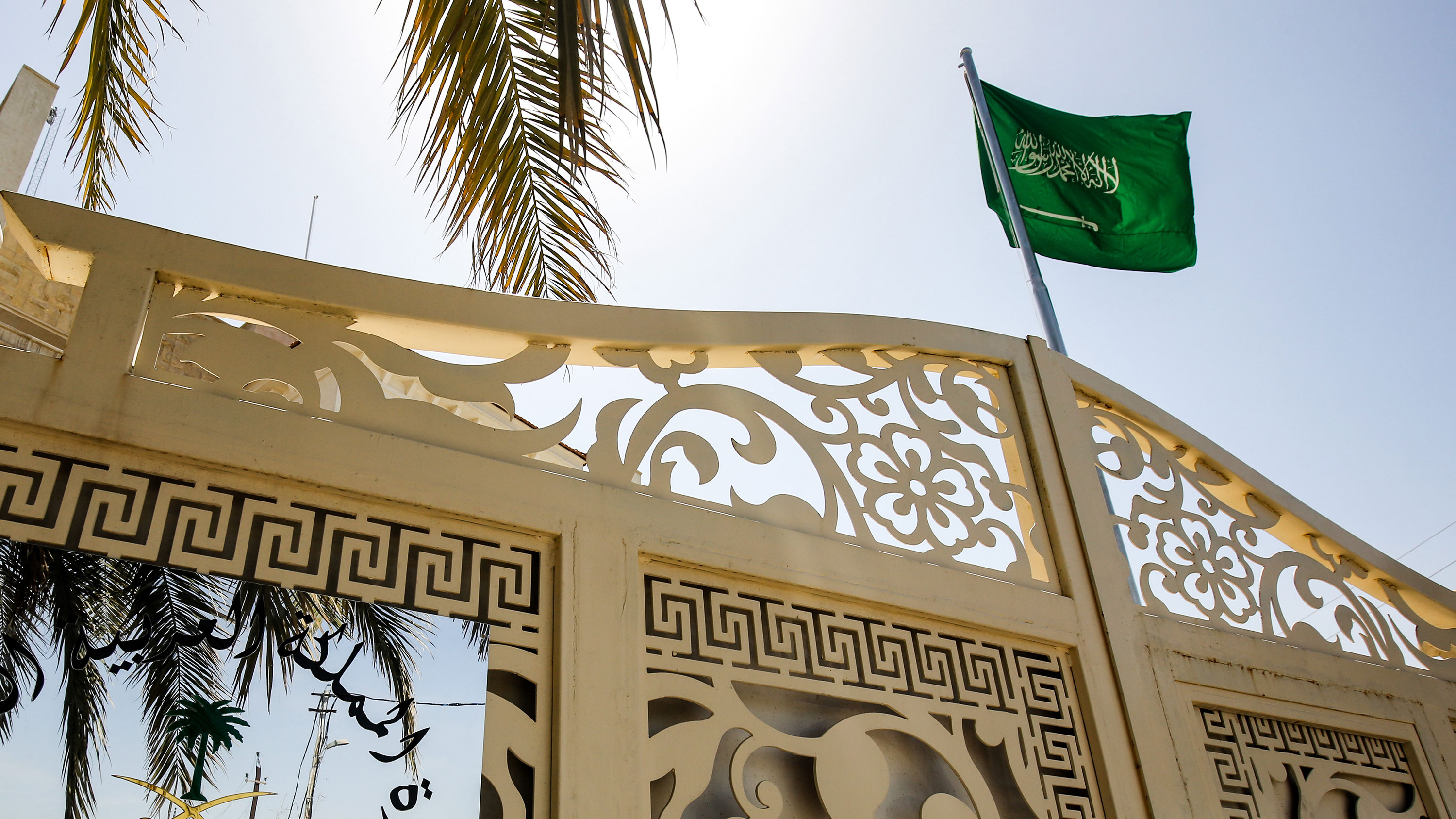 The Saudi Arabian flag flies above the Saudi consulate headquarters in Baghdad on April 4, 2019.