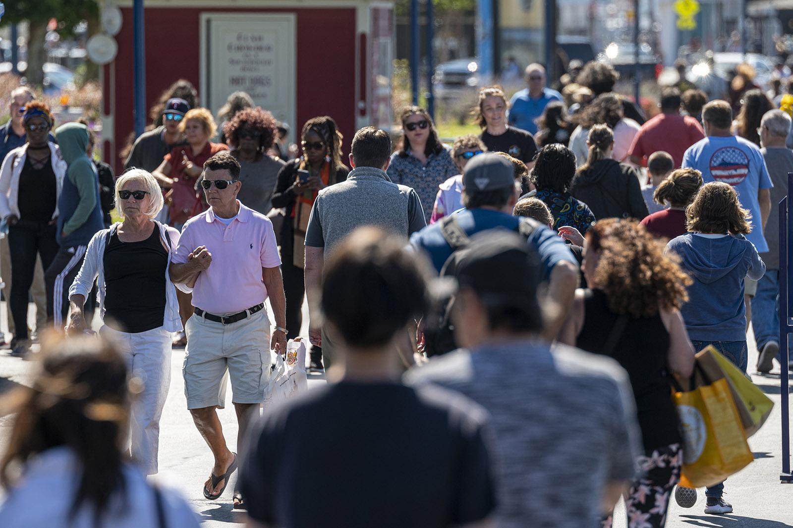 People walk on Fishermans Wharf in San Francisco, California, on June 15, 2021.