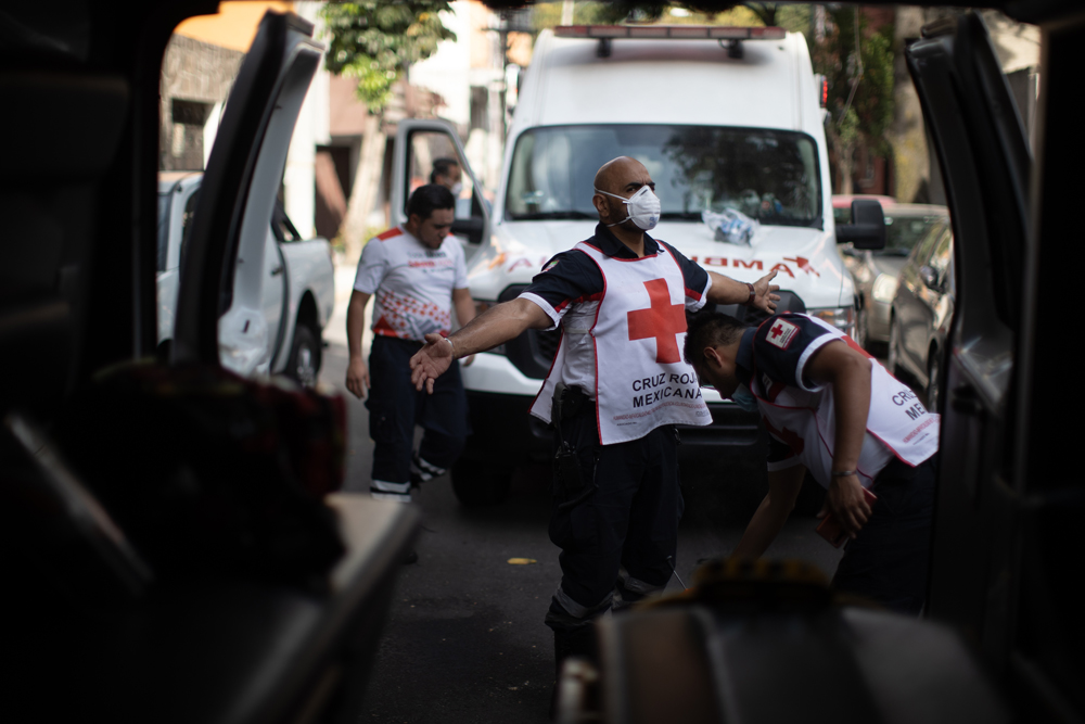 Oscar Espindola of the Mexican Red Cross is disinfected after responding to a probable Covid-19 call on June 19 in Mexico City.