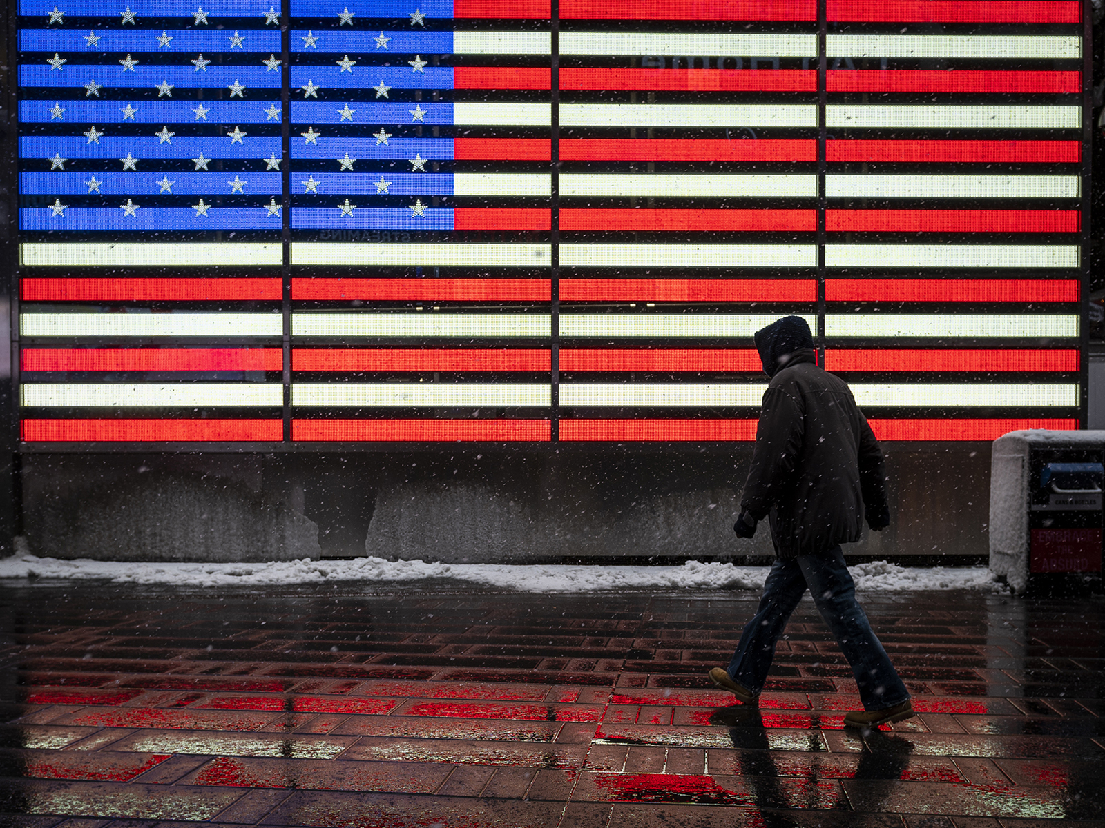 A pedestrian walks through Times Square during a winter storm in New York on Friday, February 19.