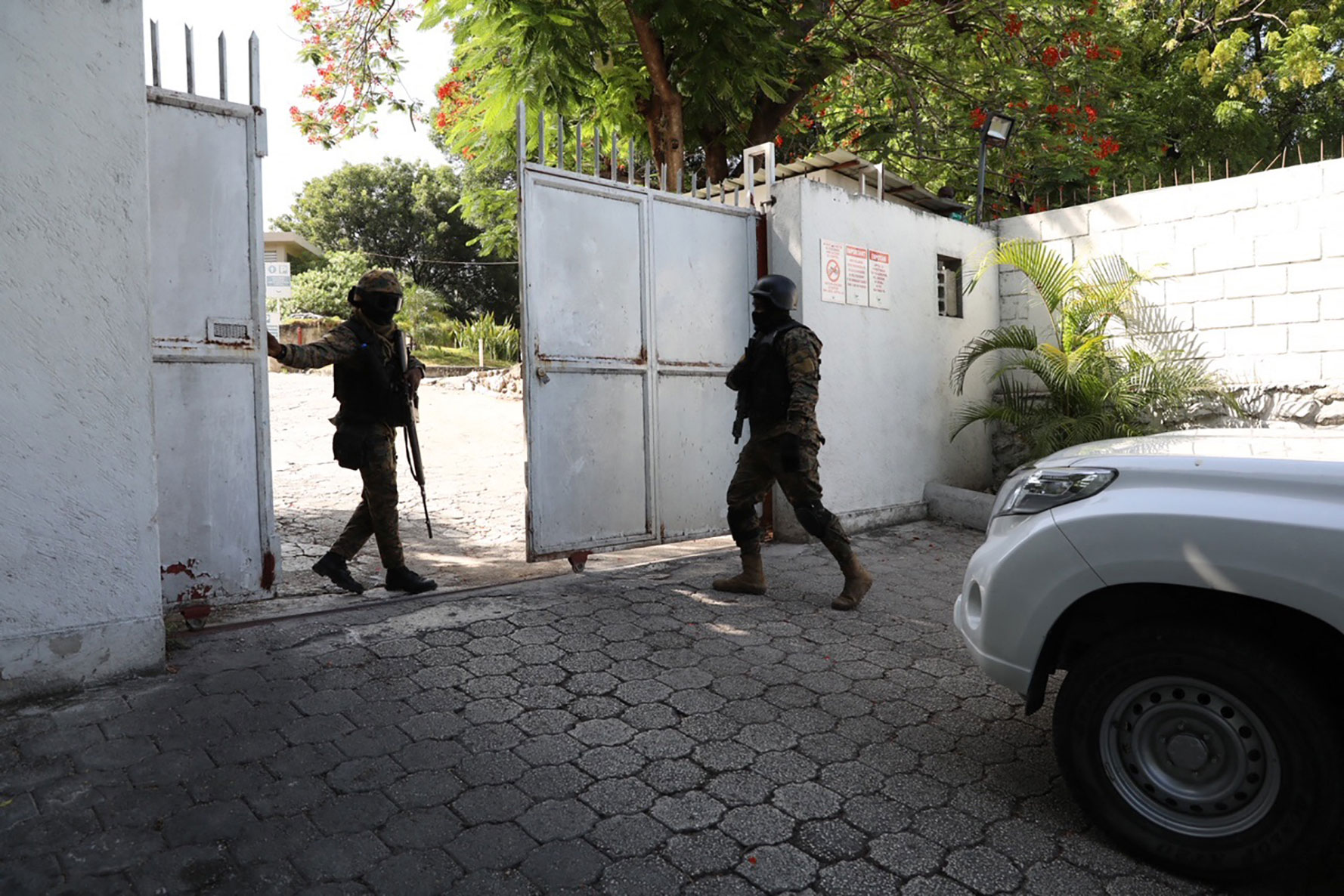 Members of the military are seen near the hospital where Haitian first lady Martine Moise was taken on July 7.