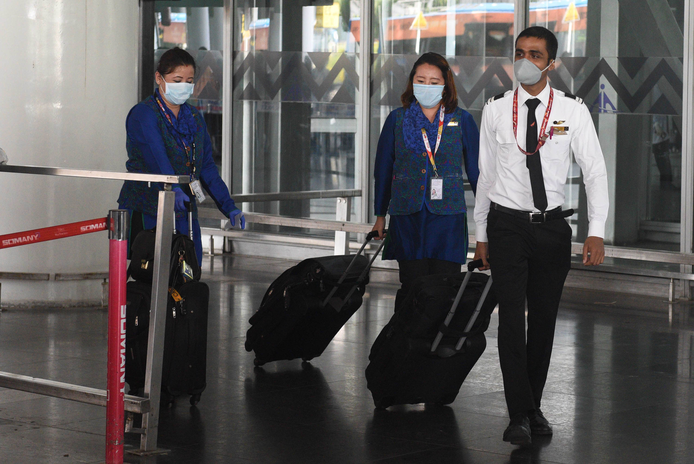 Air India crew exit the Netaji Subhash Chandra Bose International Airport in Kolkata, India, on Monday, May 18.