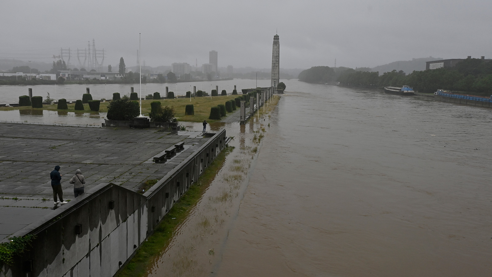 Illustration showsfloods at the Monsin dam bridge in Liege after heavy rainfall on Thursday.