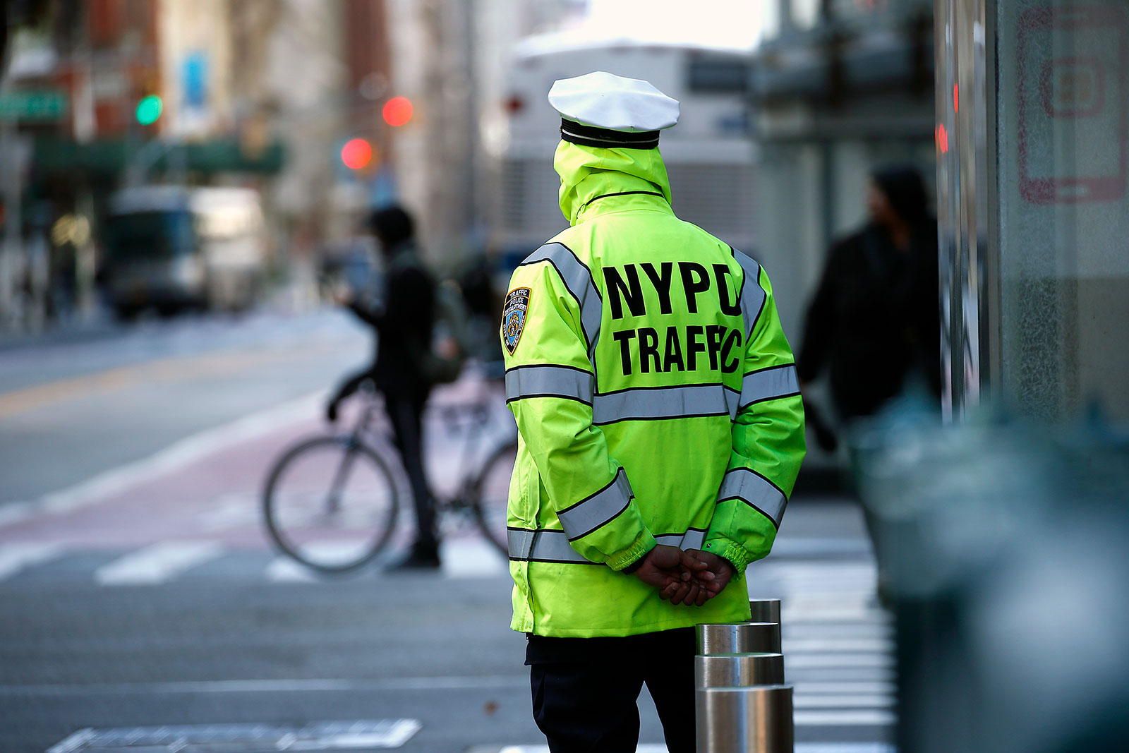 An NYPD traffic officer stands on 23rd street in New York City on April 1.