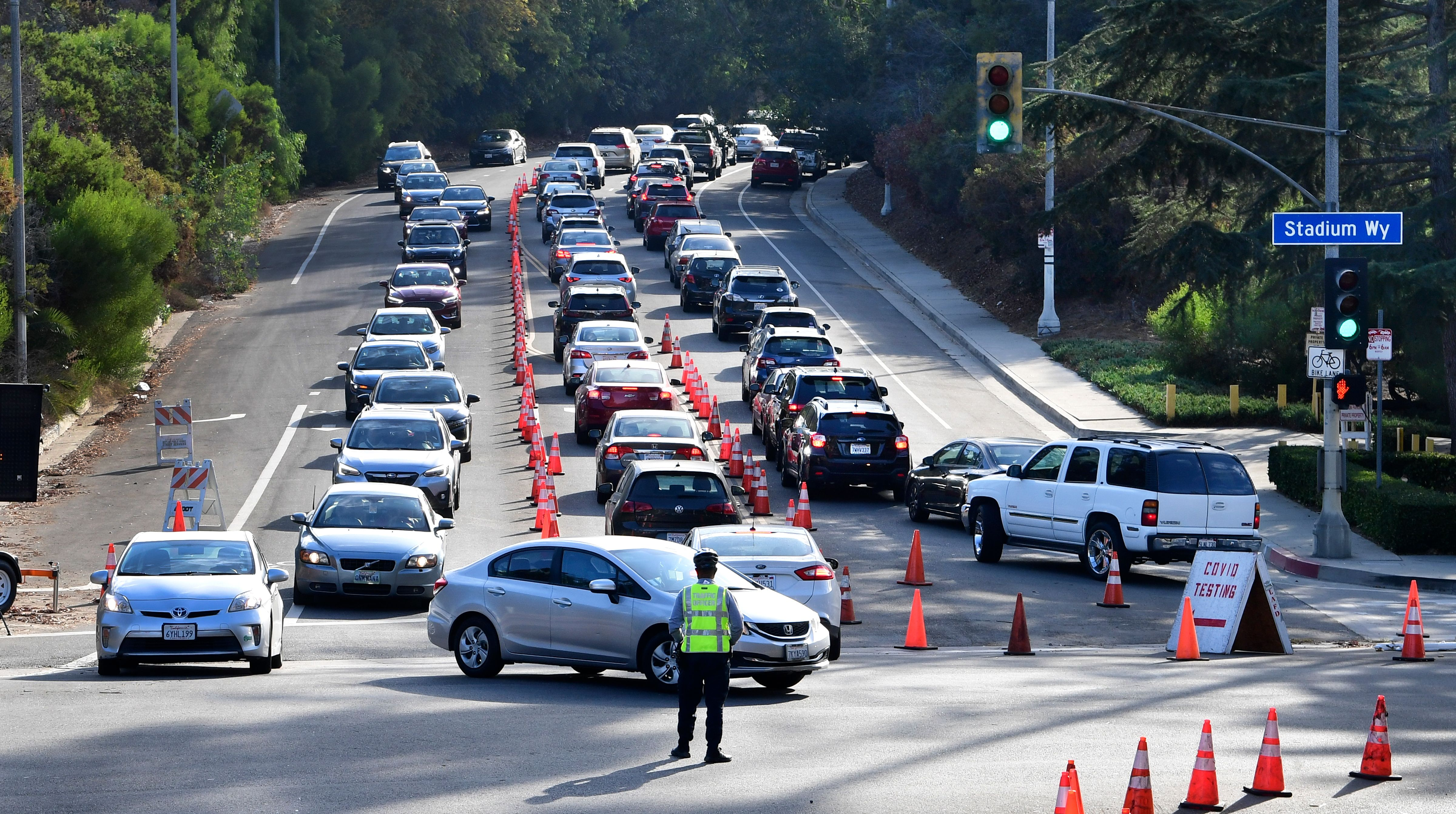 Lines of vehicles make their way to and from Dodger Stadium for Covid-19 testing on Friday, November 20, in Los Angeles.