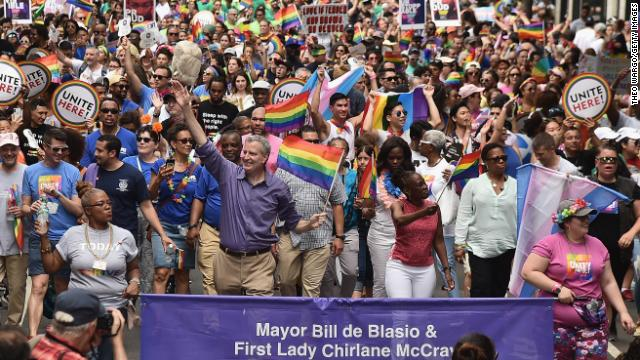 Mayor Bill de Blasio waves to the crowd during the 2018 Pride March in New York City.