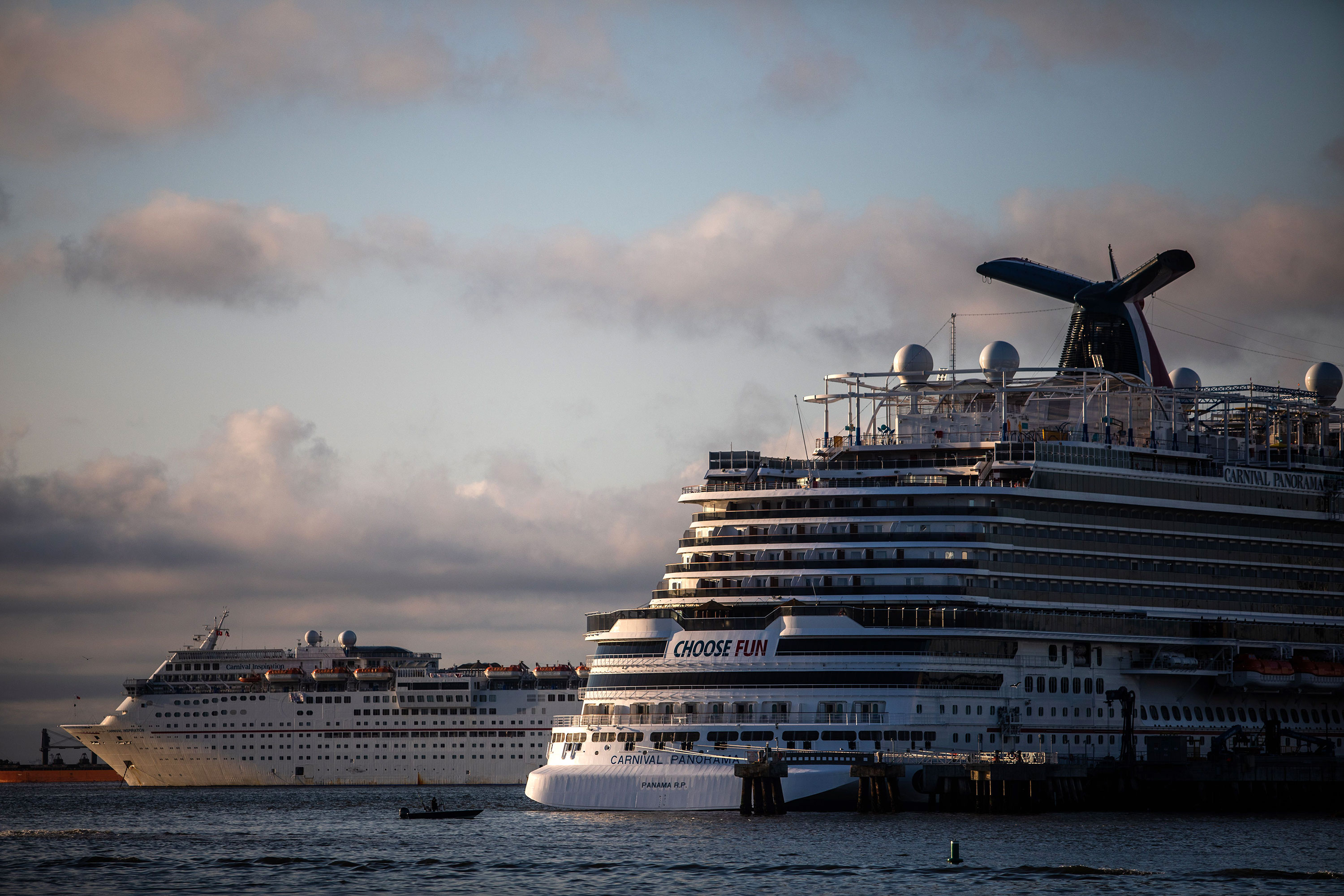 Cruise ships are seen docked in the Port of Long Beach due to a no-sail order on April 11 in Long Beach, California.