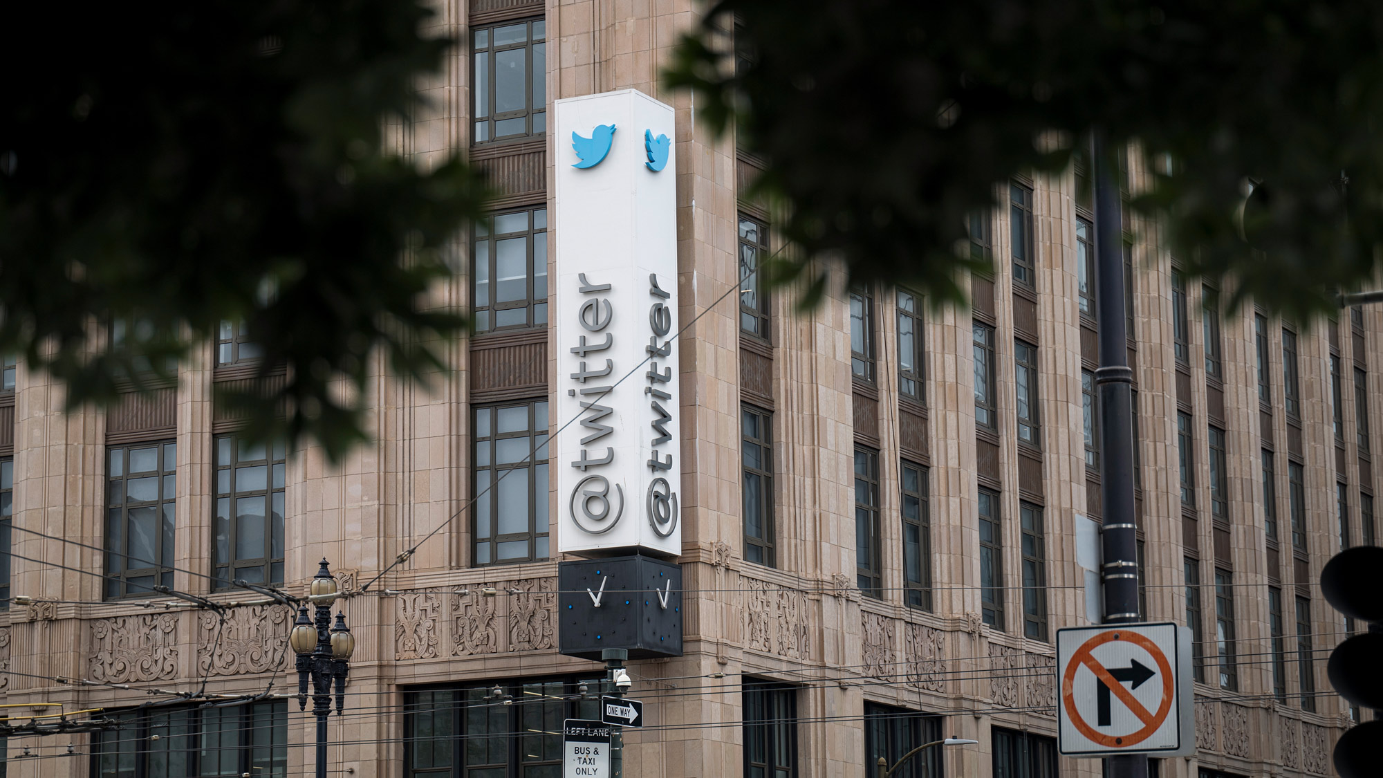 Signage is displayed outside of Twitter headquarters in San Francisco, California, on July 16.